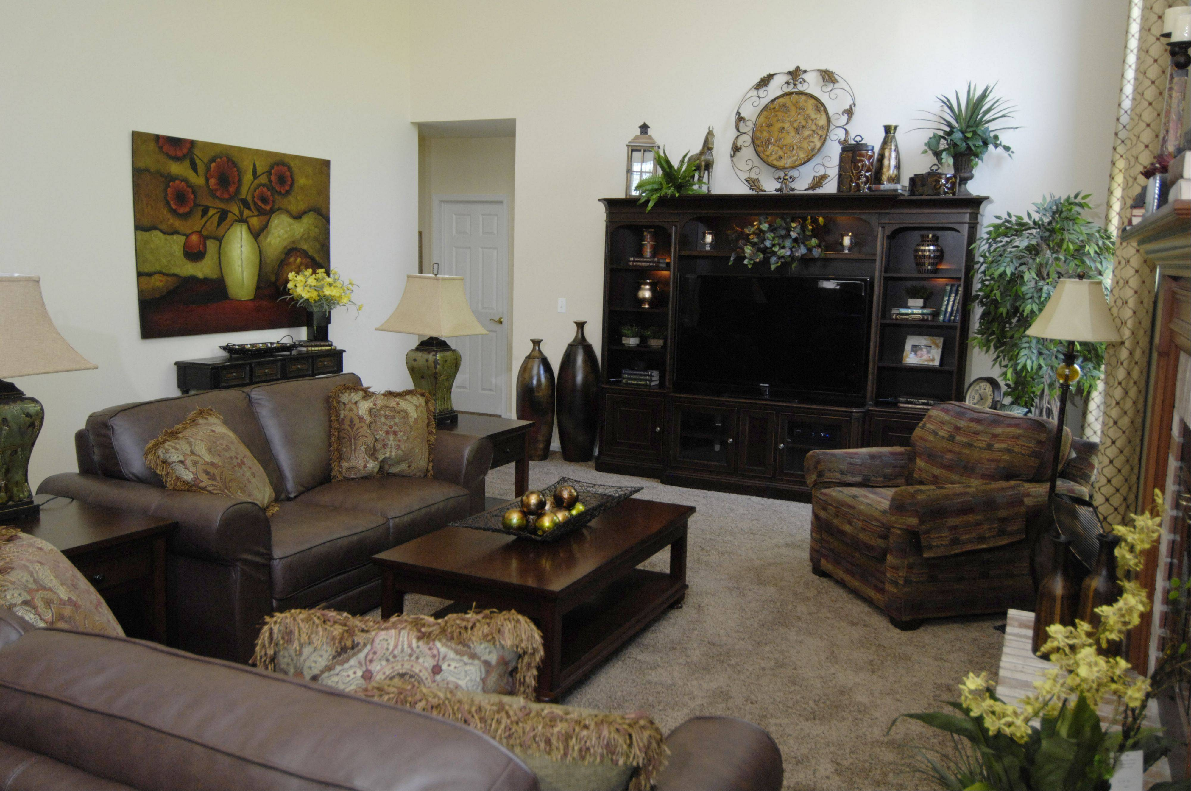 The entertainment center and chair are new, the homeowners had the leather couches.