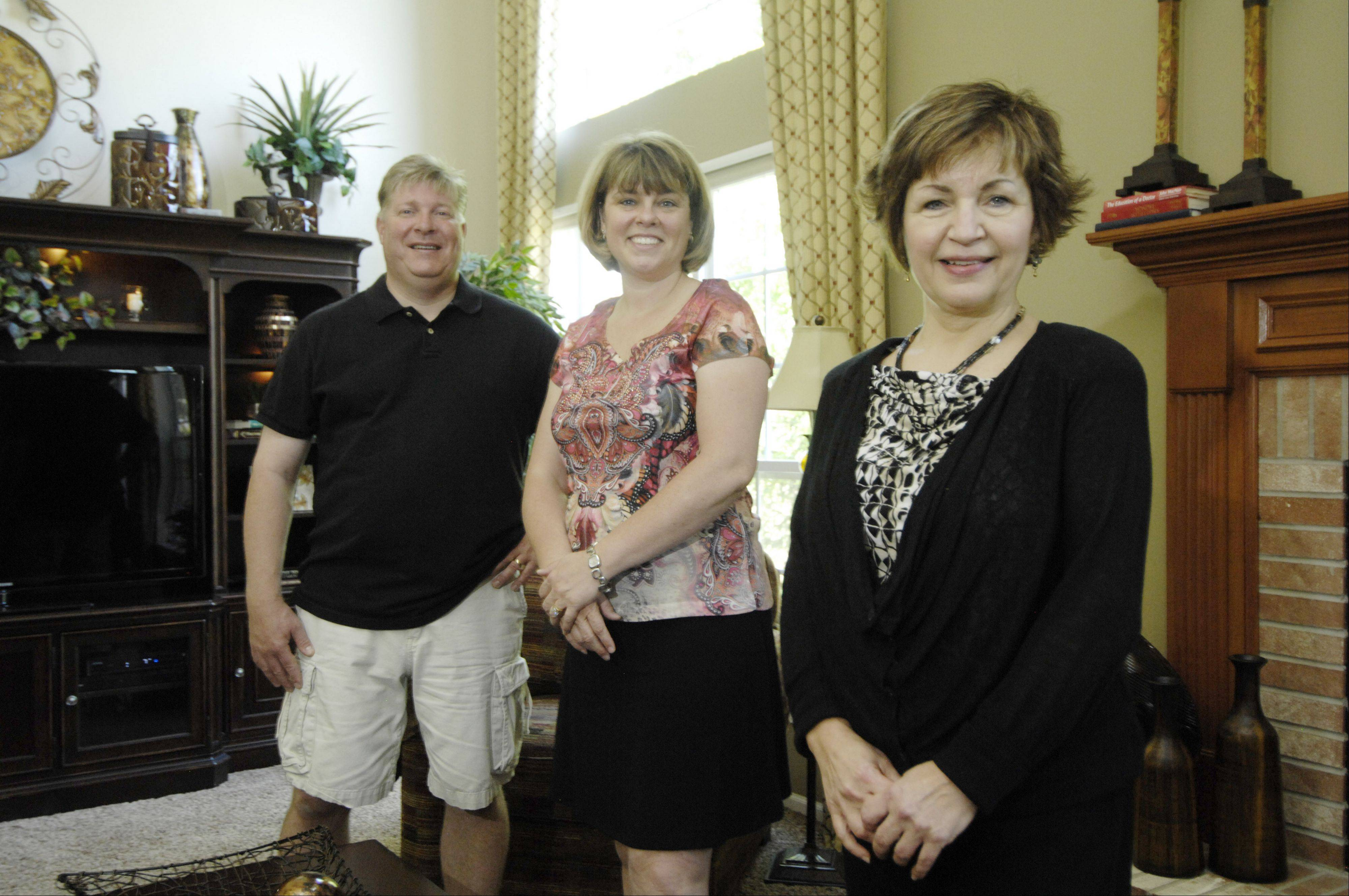 Heinz and Kirsten Titze stand in their family room with Deb Goetz, a designer at Steinhafels in Vernon Hills.