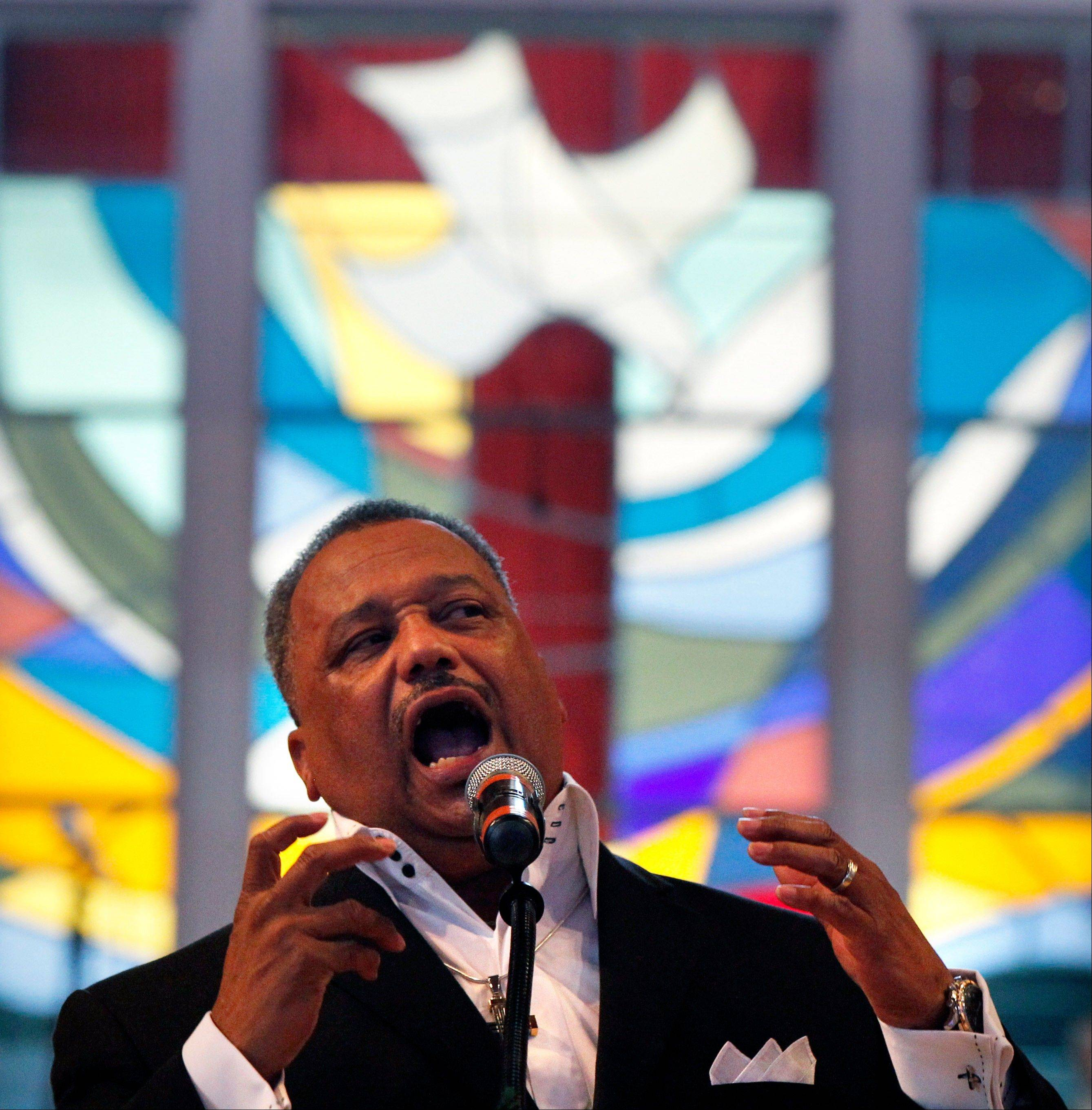 Rev. Fred Luter, pastor of the Franklin Avenue Baptist Church, delivers a sermon during Sunday Services at the Church in New Orleans on June 3. The new face of a Christian denomination that formed on the wrong side of slavery before the Civil War could be an African-American preacher who grew up in New Orleans' Lower 9th Ward. The Southern Baptist Convention holds its annual meeting in New Orleans next week, and it could see the election of Luter as president. Faced with growing diversity in America and declining membership in its churches, the denomination is making a sincere effort to distance itself from its troubled racial past.