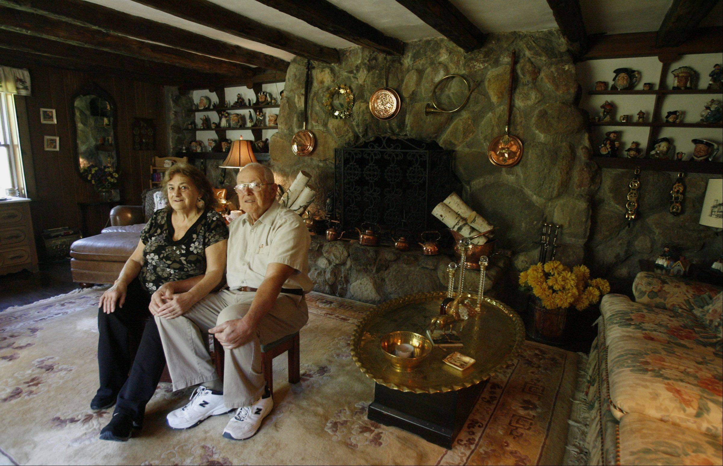 Patricia and Kenneth Rockett sit in one of the original rooms they kept when they rebuilt their Long Grove home.
