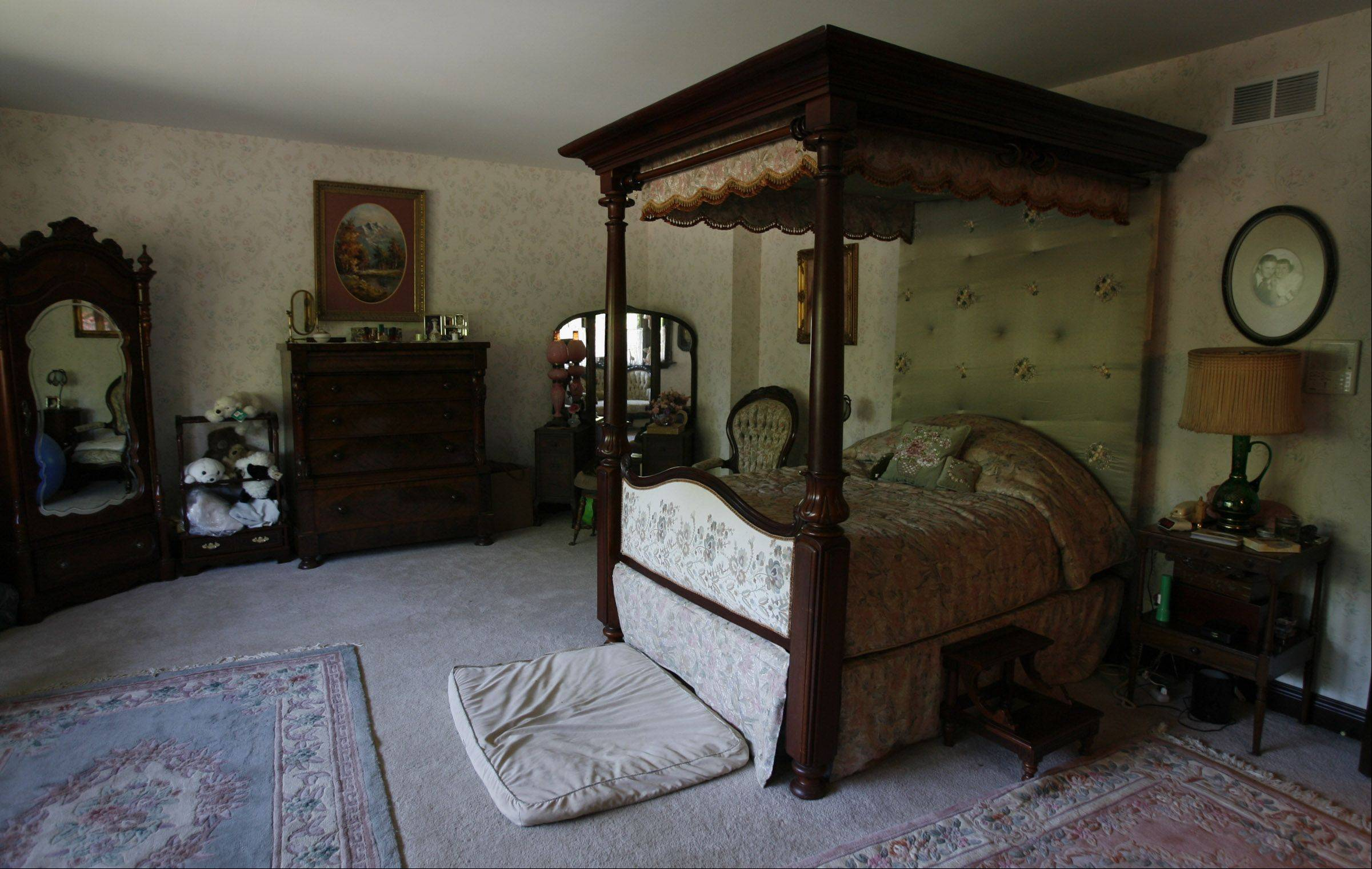 The bed is, of course, an antique.