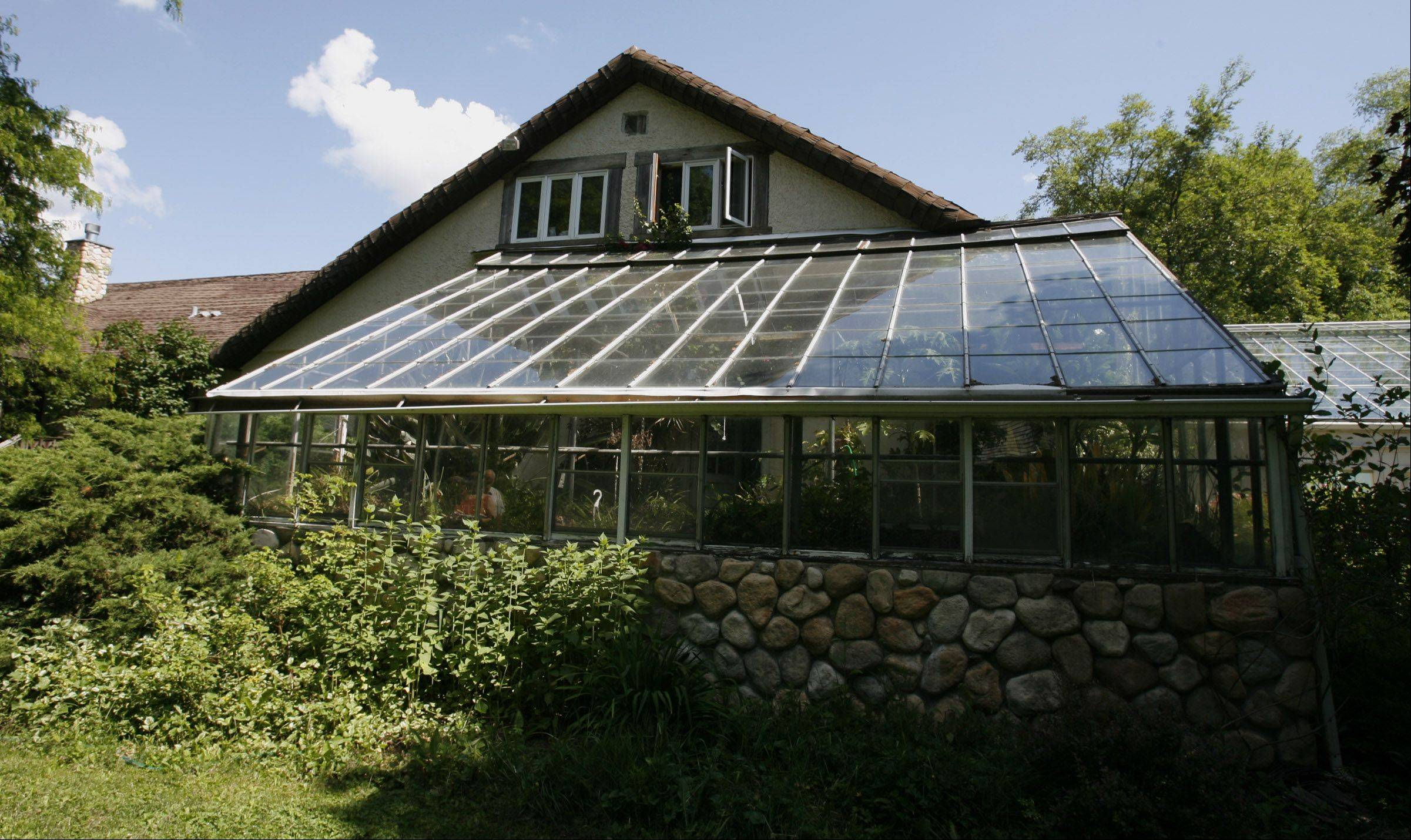 The Long Grove home has a greenhouse in the rear.