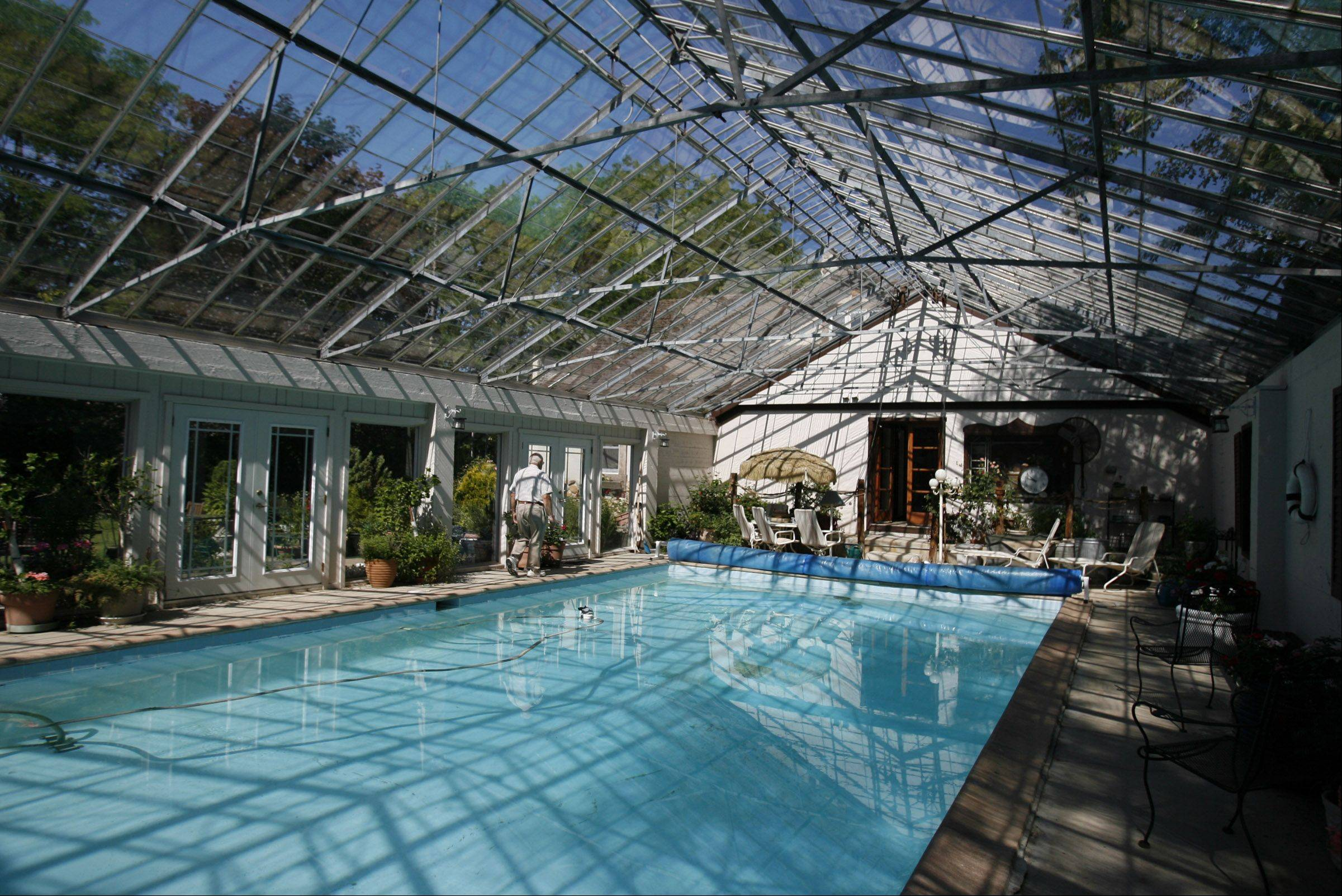 The swimming pool under a glass roof where some of the panes open is spectacular.