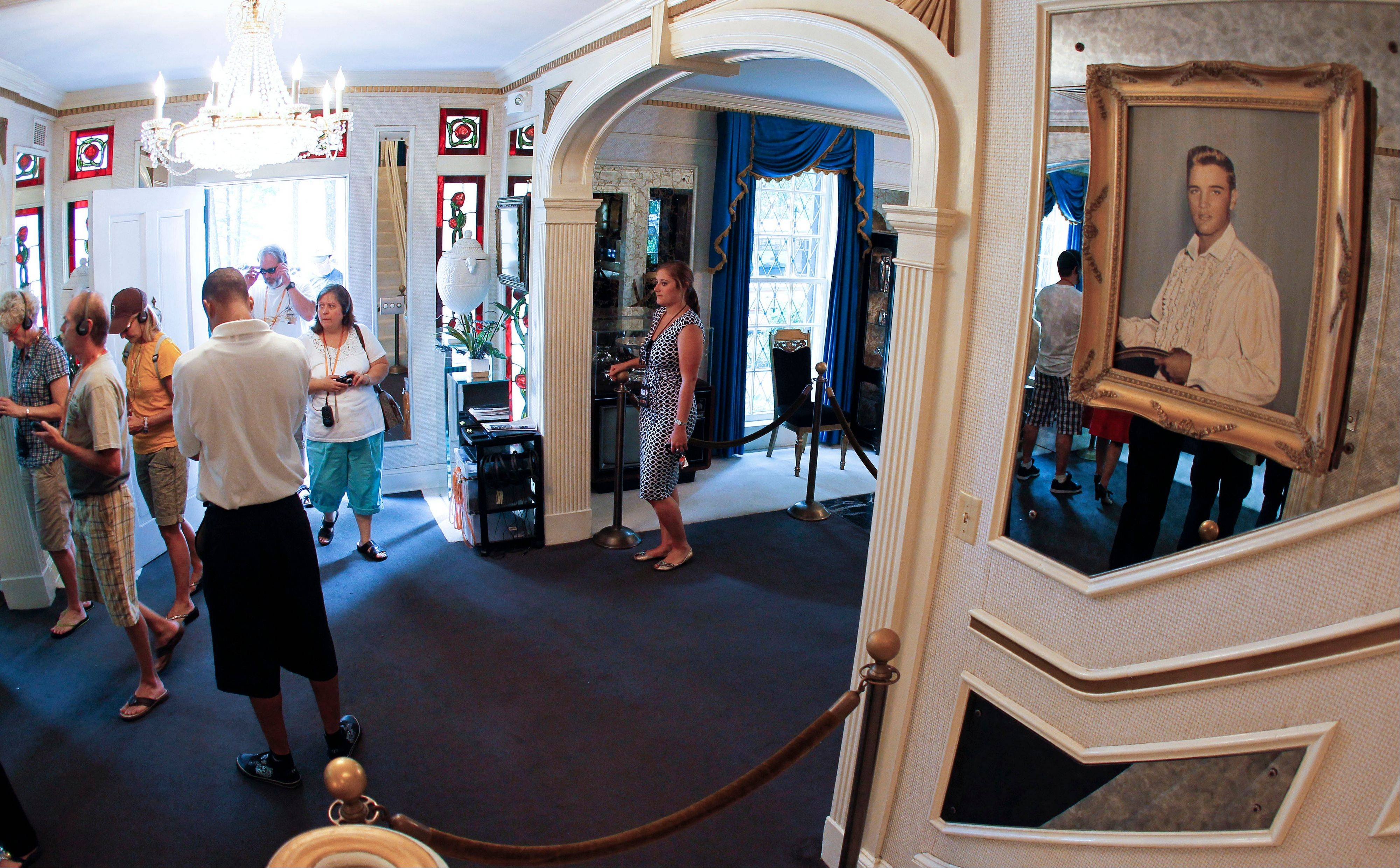 Tourists arrive through the front door of Graceland, Elvis Presley's home in Memphis, Tenn.