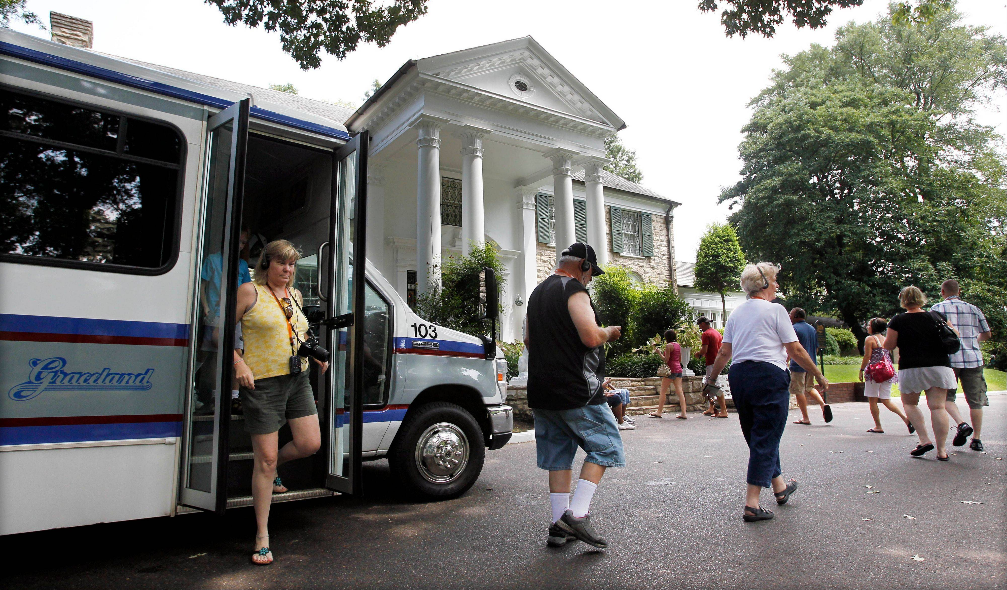 Tourists arrive at Graceland, Elvis Presley's home in Memphis, Tenn.