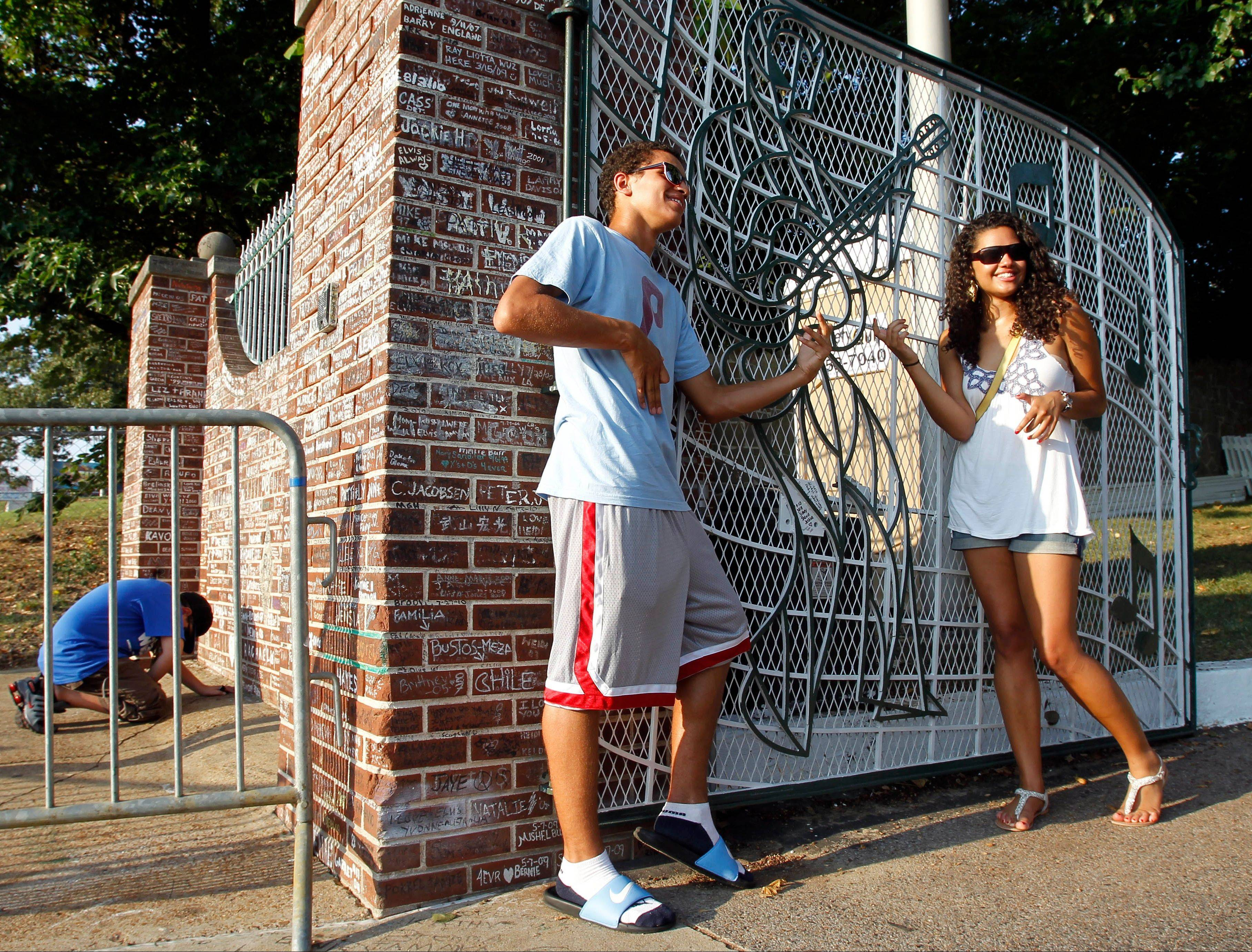 Those not lucky enough to get a ticket to enter Graceland can always pose at the gates.
