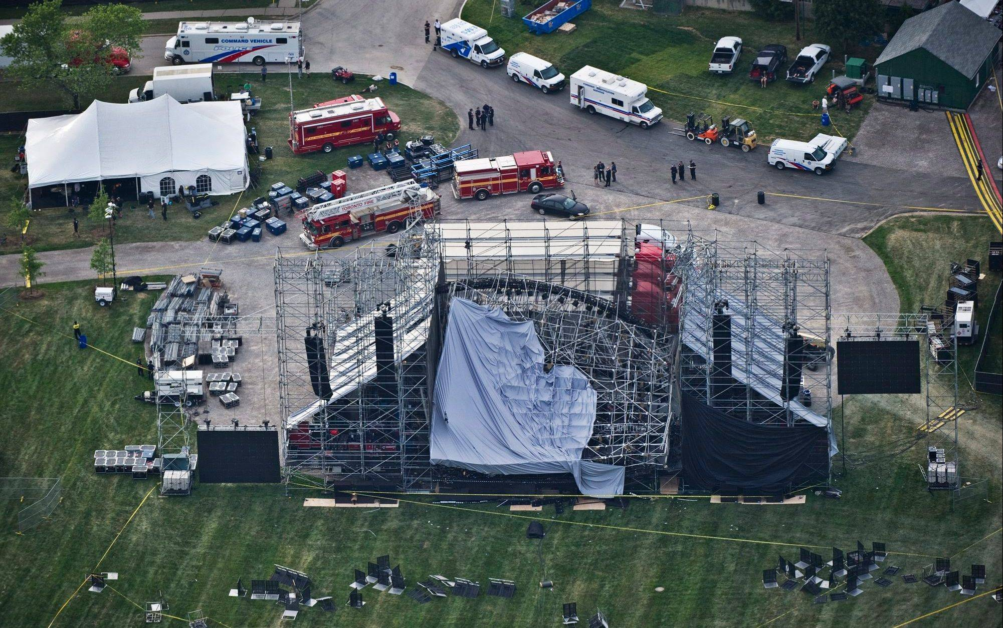 This aerial view shows a collapsed concert stage Saturday at Downsview Park in Toronto. The top of a stage being set up for a concert by band Radiohead collapsed, killing one of the stage workers preparing for the event.