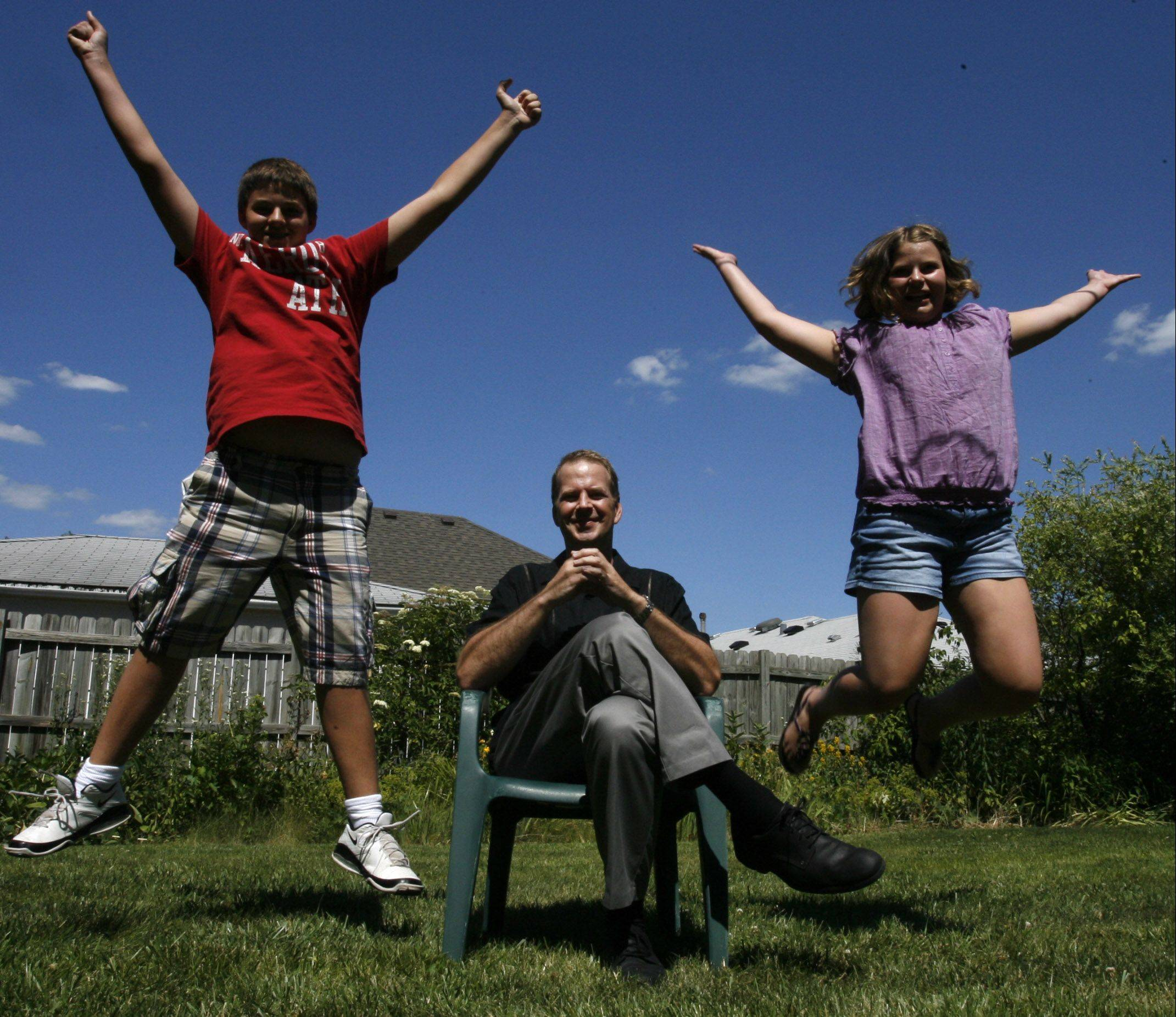 Ray Summins with son, Sam, 13, and daughter Alison, 10, at their home in Hoffman Estates last week.