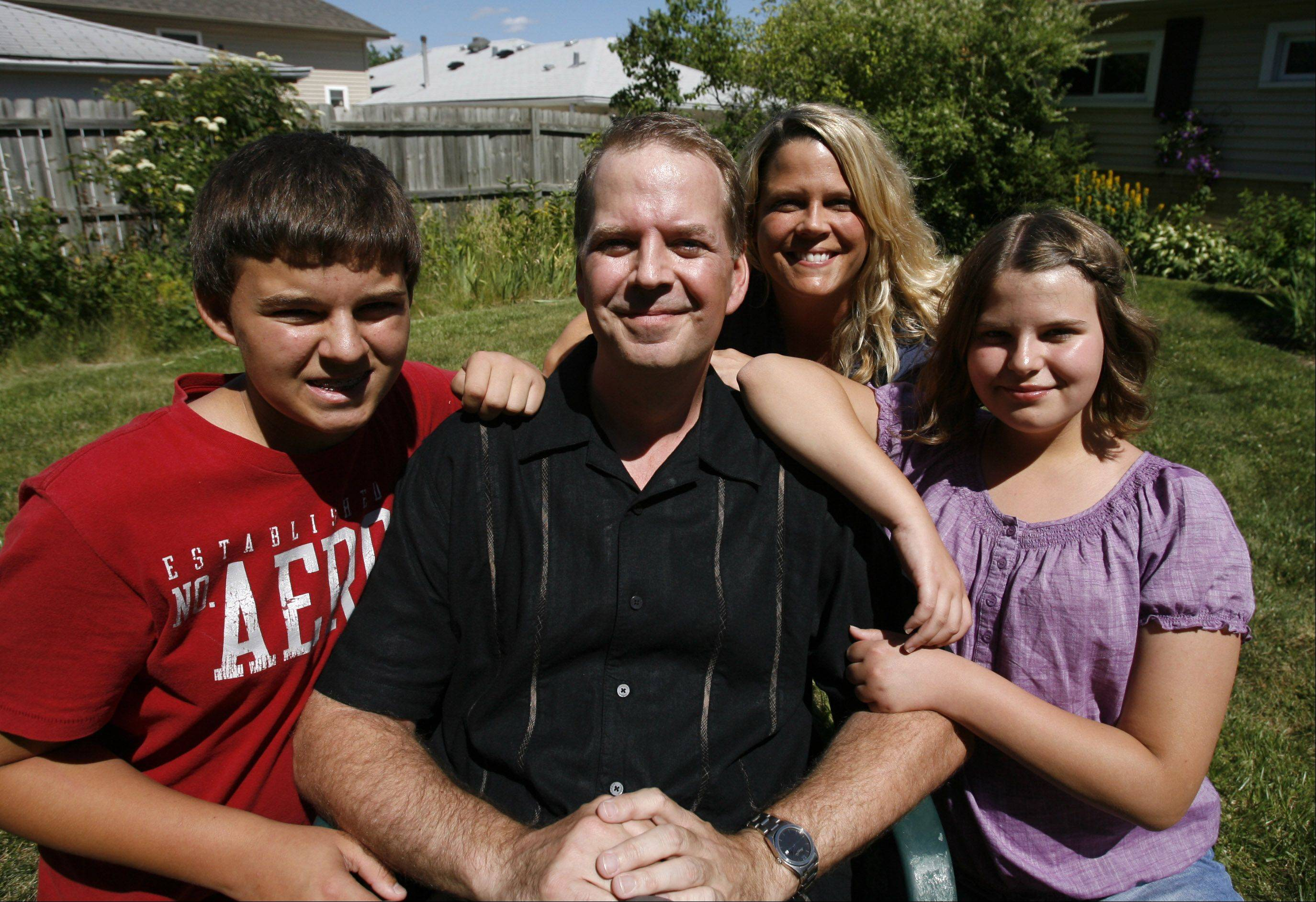 Ray Summins with wife, Paige, son, Sam, 13, and daughter Alison, 10, at their home in Hoffman Estates last week.
