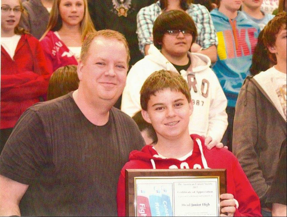 Dealing with his father's rare bone cancer gave Sam Summins the strength to give a speech during a cancer presentation in February at Margaret Mead Junior High School in Elk Grove Village. Ray Summins credits his children, Sam and Alison, with helping him recover.