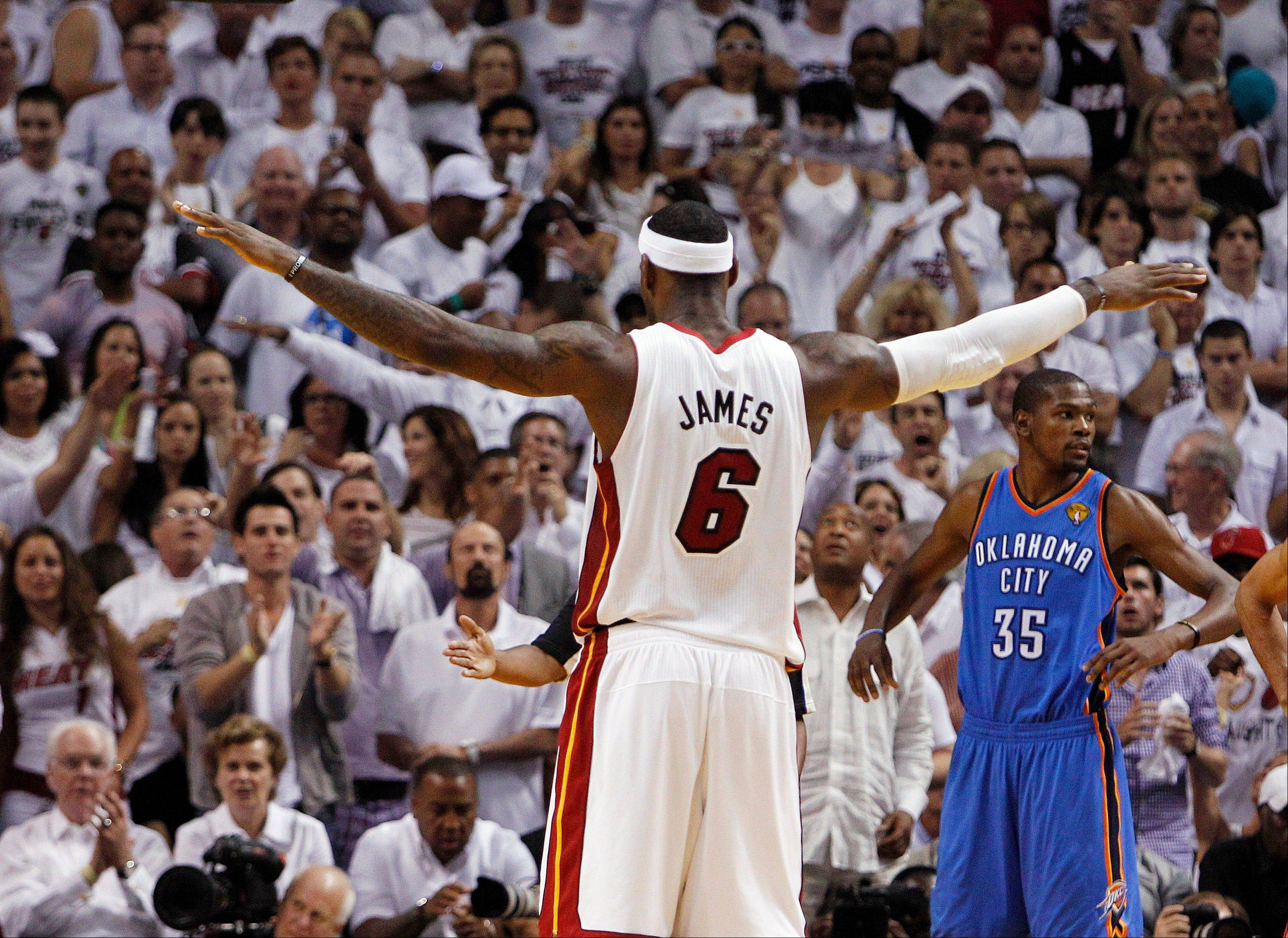 Associated Press LeBron James scored 29 points for the Miami Heat in Sunday night's victory over the Oklahoma City Thunder.