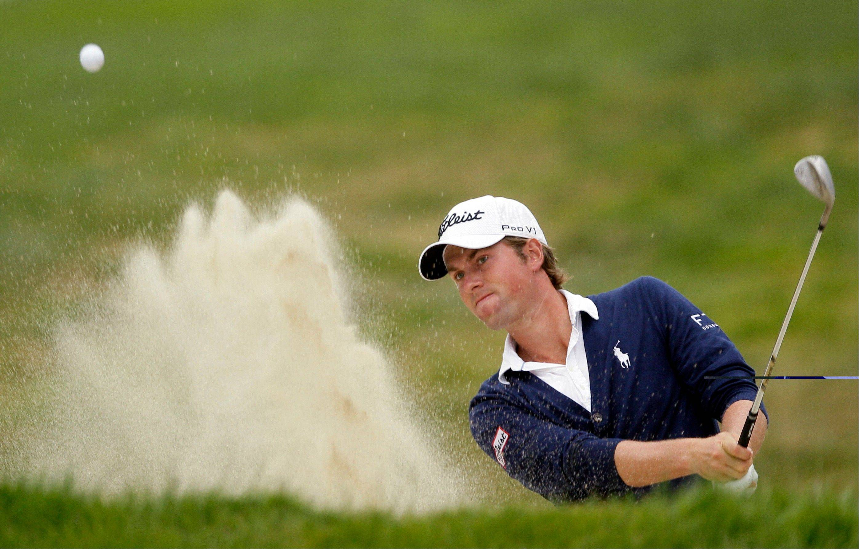 Webb Simpson hits out of a bunker on the 17th hole during the fourth round of the U.S. Open Championship golf tournament Sunday, June 17, 2012, at The Olympic Club in San Francisco.