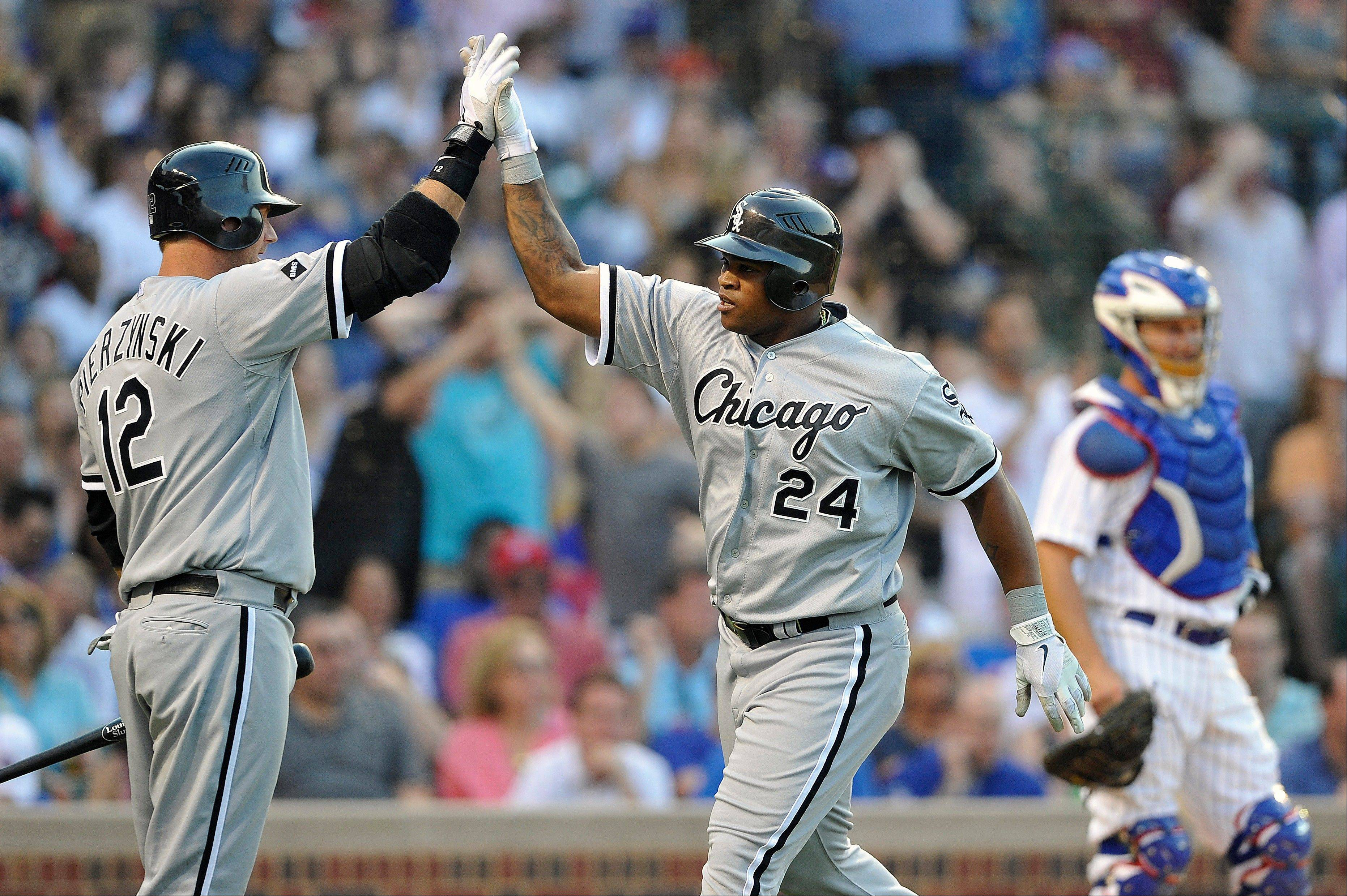 A.J. Pierzynski, left, Dayan Viciedo and the White Sox swept the Cubs in a May series at Wrigley Field.