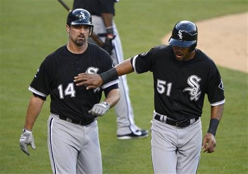 Alex Rios, right, congratulates Paul Konerko after they scored on a single by Alexei Ramirez during the second inning of a baseball game against the Los Angeles Dodgers, Saturday in Los Angeles.