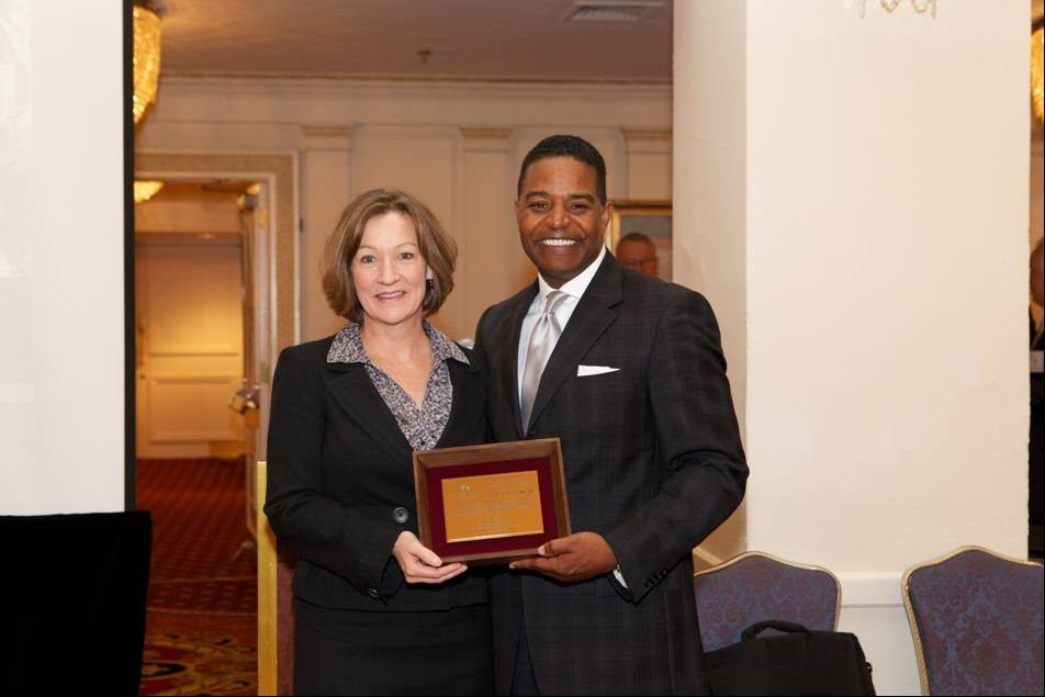 Calvin Butler receives recognition for his years of service on the Illinois Chamber of Commerce board.