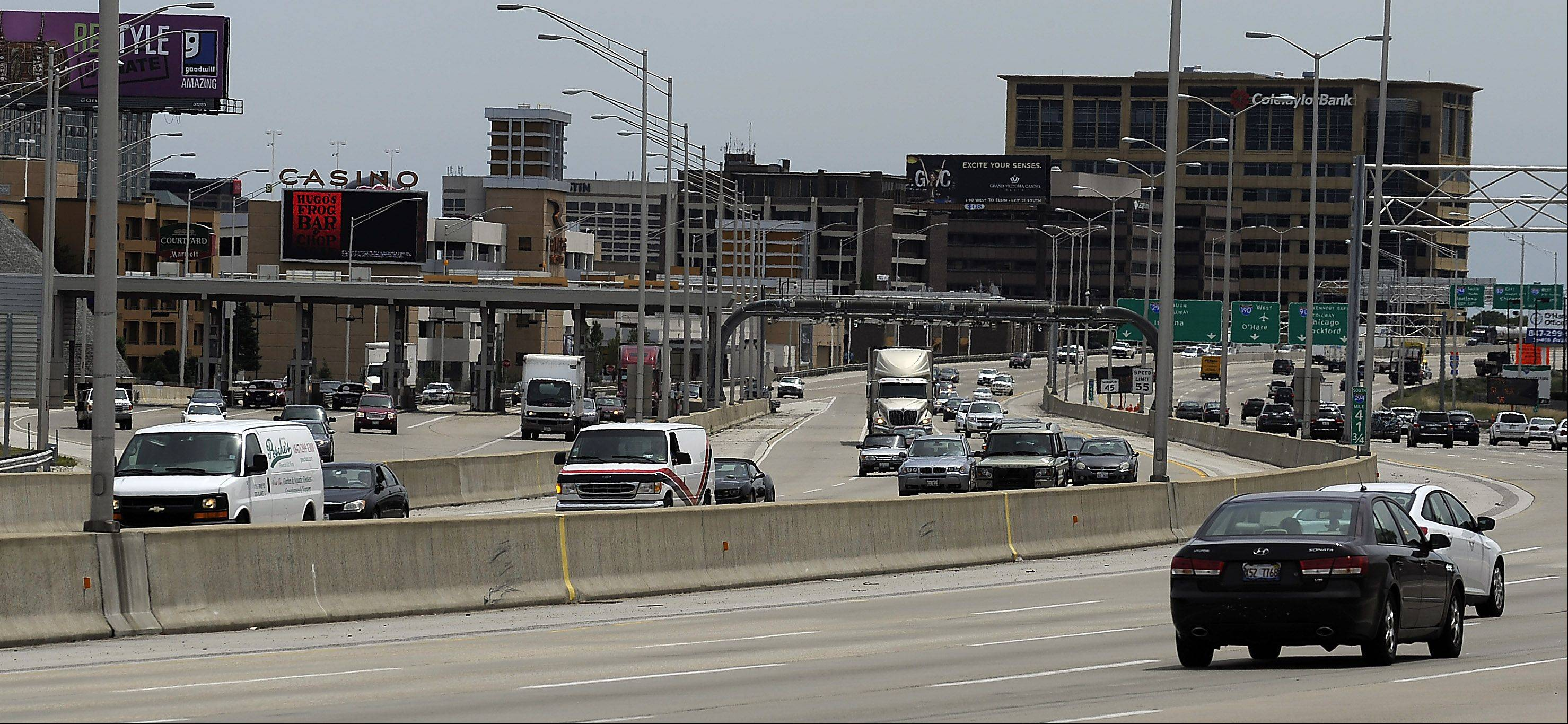 Cars pass through the Touhy Toll Plaza in Des Plaines on the Tri-State Tollway. The Tri-State brings in the most money of all the toll roads, according to a report from the Illinois State Toll Highway Authority.