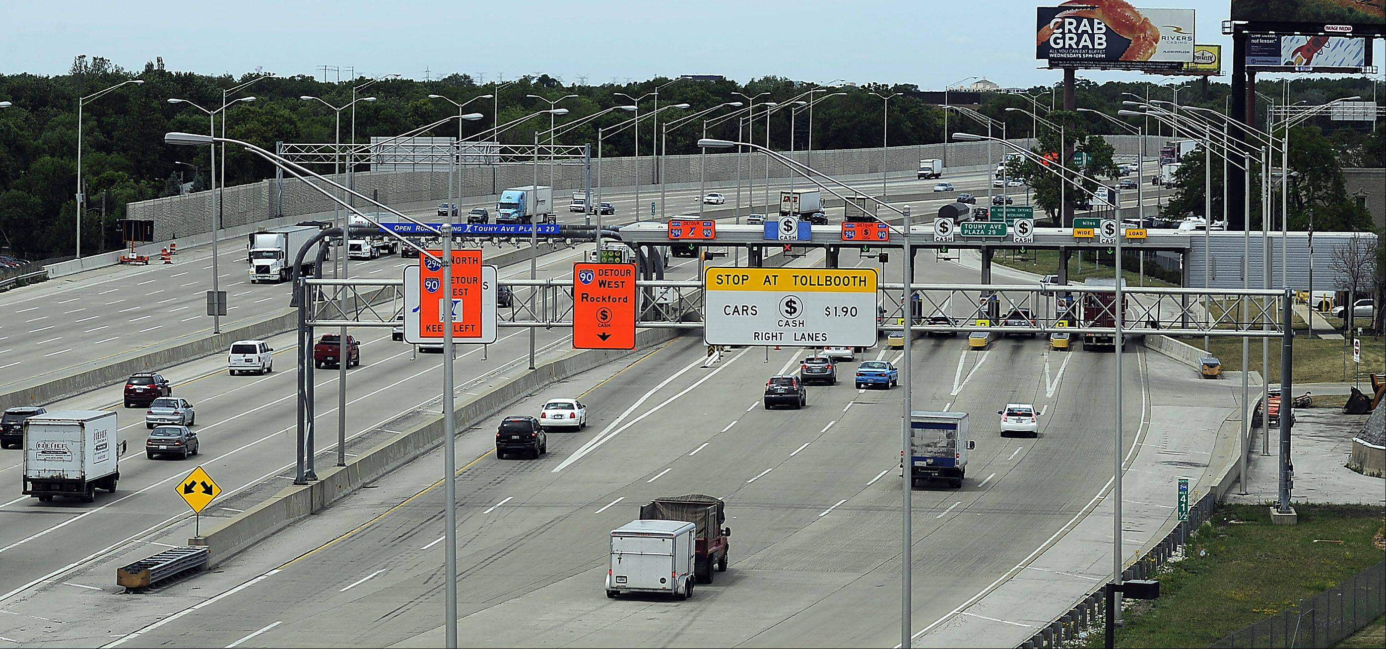 Cars pass through the Touhy Toll Plaza in Des Plaines on the Tri-State Tollway. The Tri-State brings in the most money of all the toll roads.