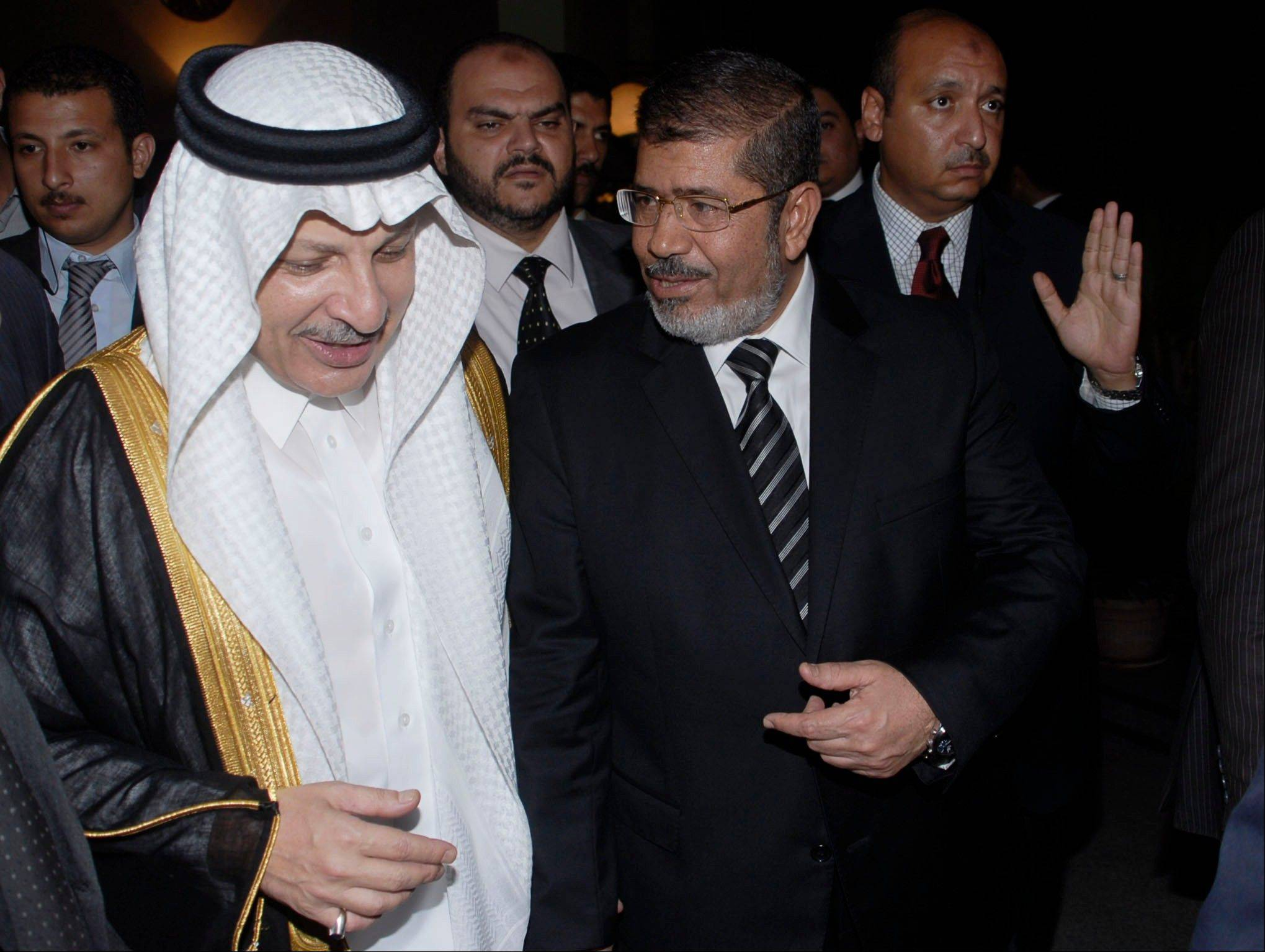 Ahmed Kattan, Saudi Arabia's ambassador to Egypt, left, and Islamist presidential candidate Mohammed Morsi attend the funeral of late Crown Prince Nayef bin Abdul-Aziz in Cairo on Monday. Morsi claimed victory Monday in Egypt's presidential vote.