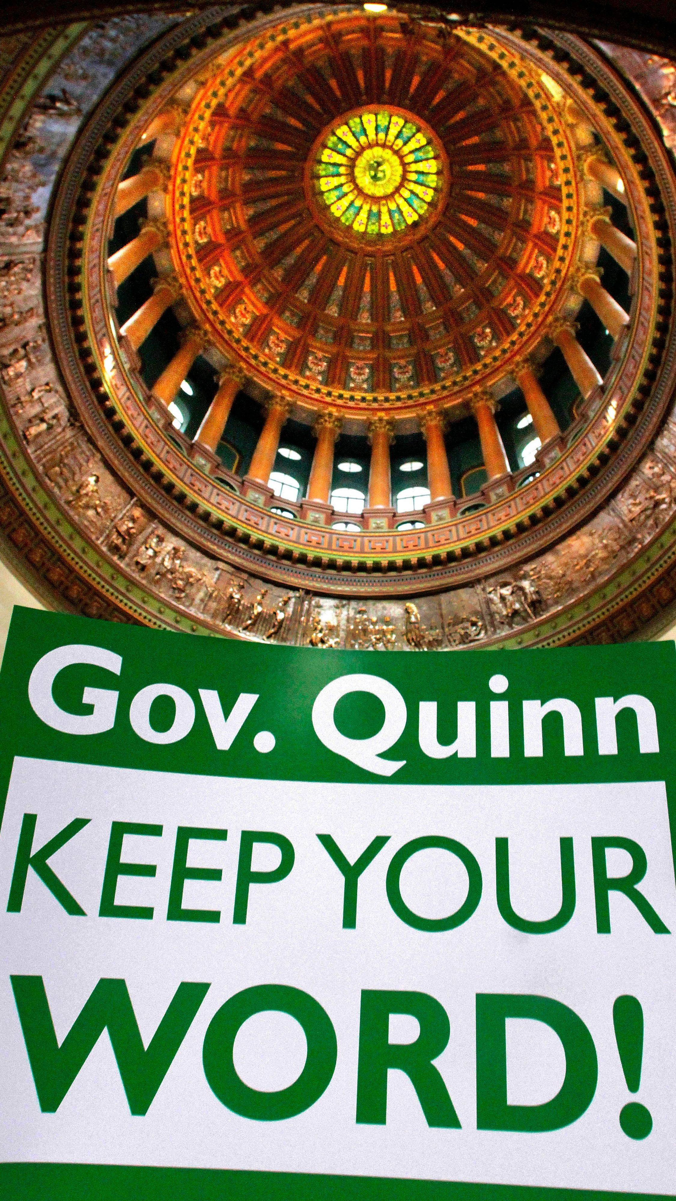 A protester outside the governor's office in Springfield last February sought to pressure Gov. Pat Quinn on the volatile issue of public employee pension funding.