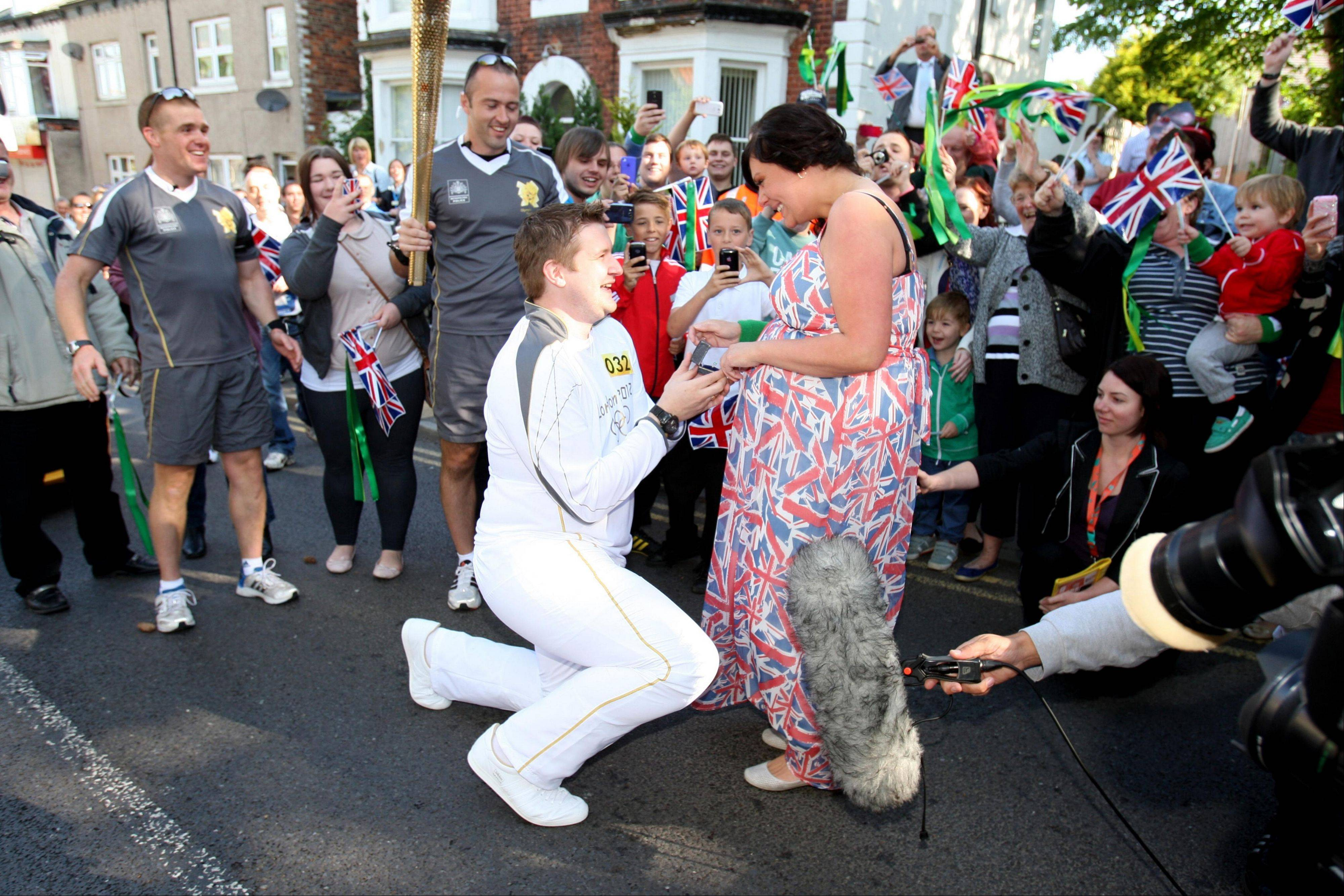 Olympic relay Torchbearer David State stopped midway through his Torch Relay leg between Marske-by-the-Sea and Loftus, England, to propose to his girlfriend, Christine Langham, before continuing the relay Monday June 18.