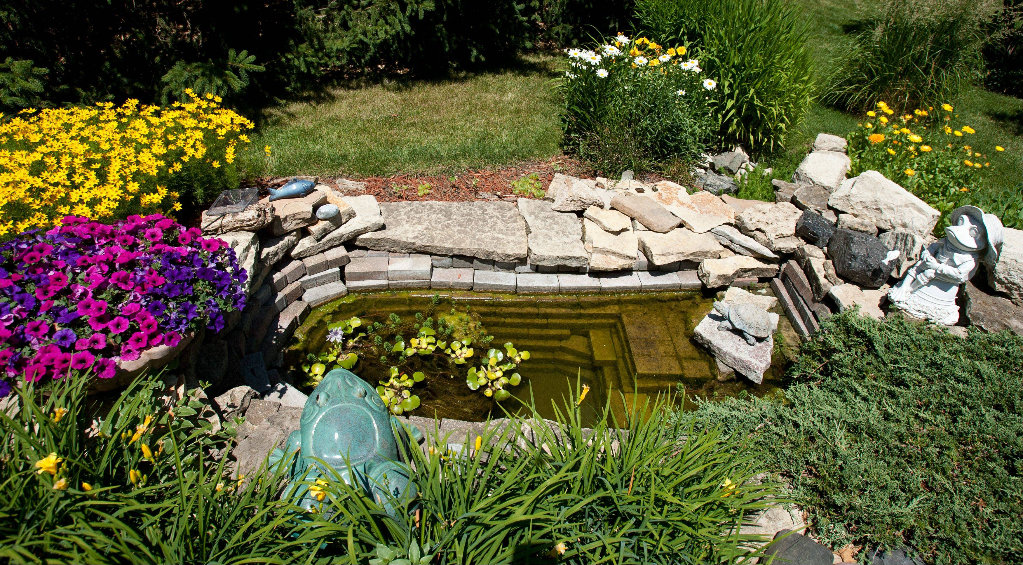 The Lenkes' Lisle yard includes water features, like the small collecting basin and a trailing creek. The garden is among seven private yards featured on the Lisle Woman's Club's Garden Gait tour on Sunday, June 24.