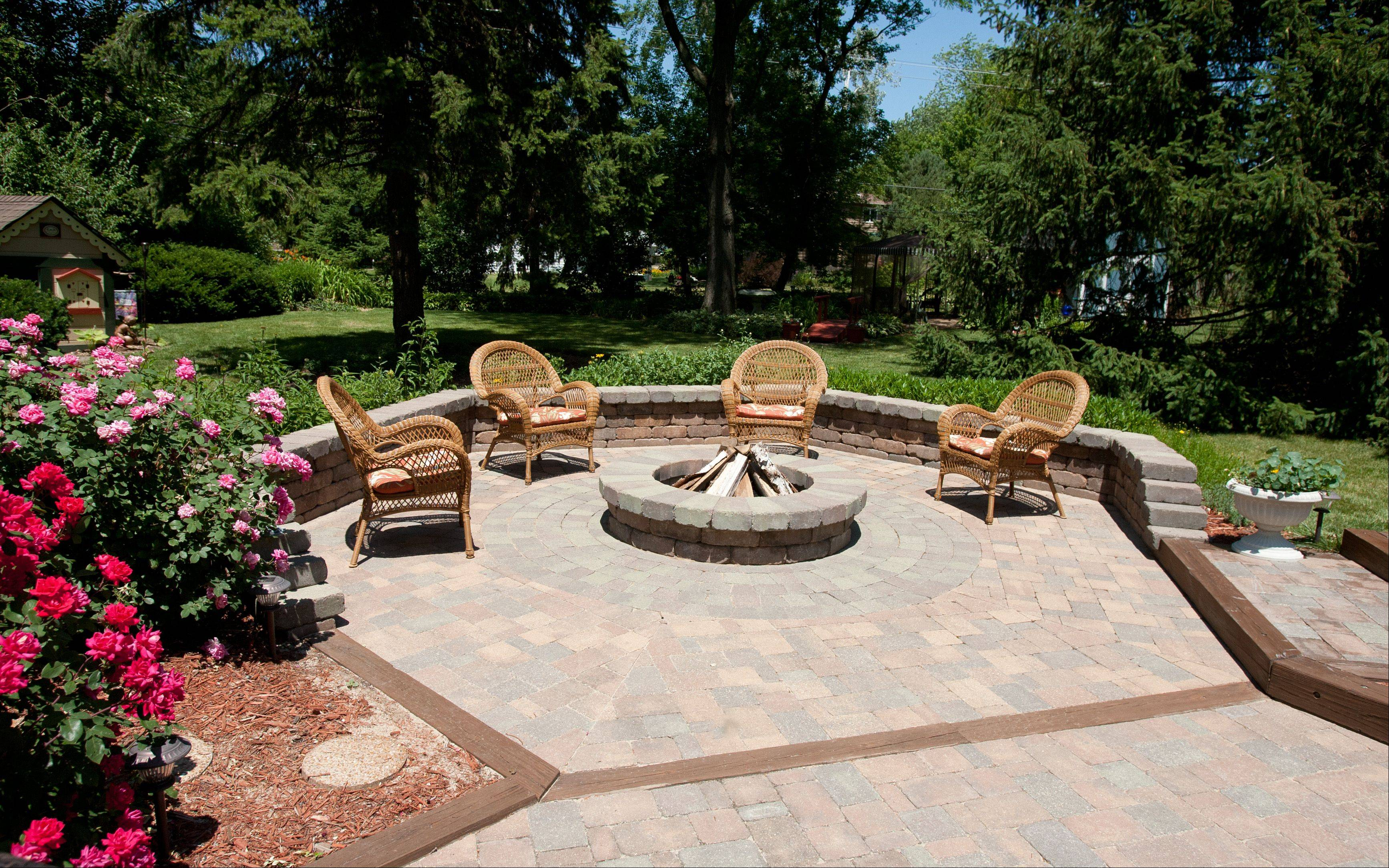 The Lenkes' multi-level patio -- complete with fire pit -- is a favorite place for the Lisle couple to entertain.
