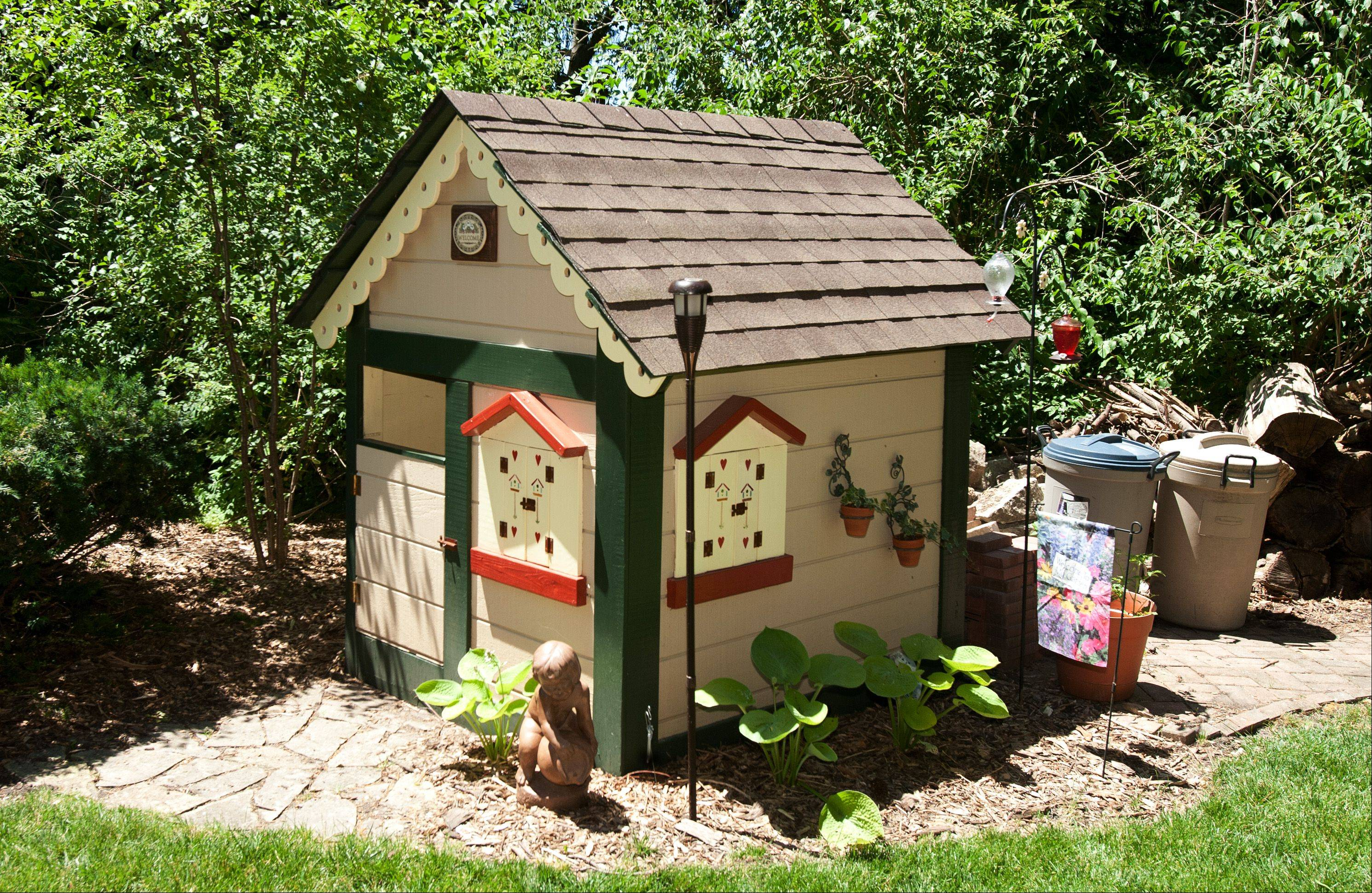 The backyard of Kathy and Gary Lenke is one stop on the Lisle Woman's Club's Garden Gait walk on Sunday, June 24. The couple converted their children's playhouse into a whimsical garden shed.
