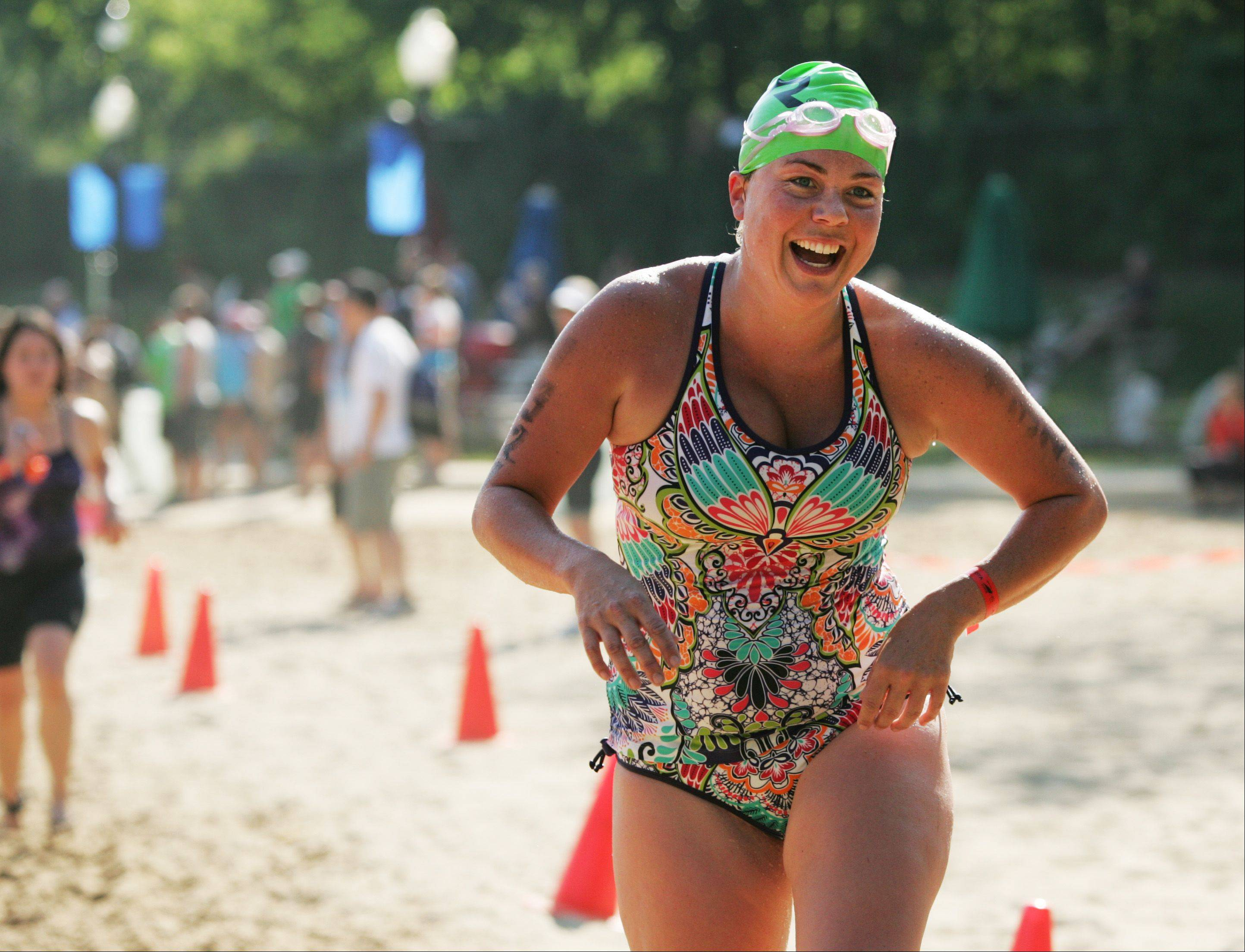 Anne Riordan of St. Charles exits the swimming phase of the first leg of the Naperville Triathlon.