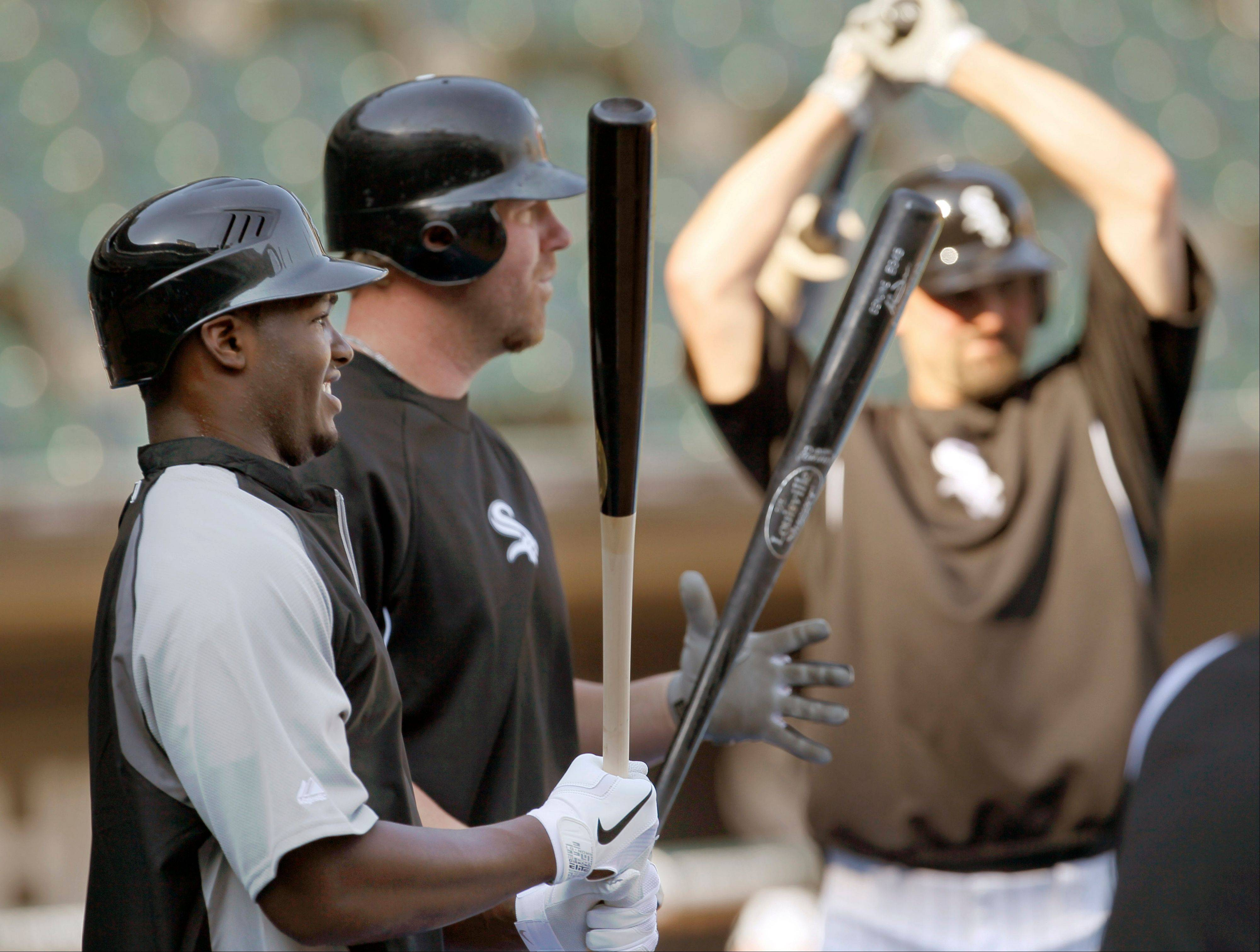 Chicago White Sox first round draft pick outfielder Courtney Hawkins, left, from Carroll High School in Corpus Christi, Texas stands next to Adam Dunn and Paul Konerko, as he participates in batting practice before an interleague baseball game against the Chicago Cubs Monday, June 18, 2012, in Chicago.