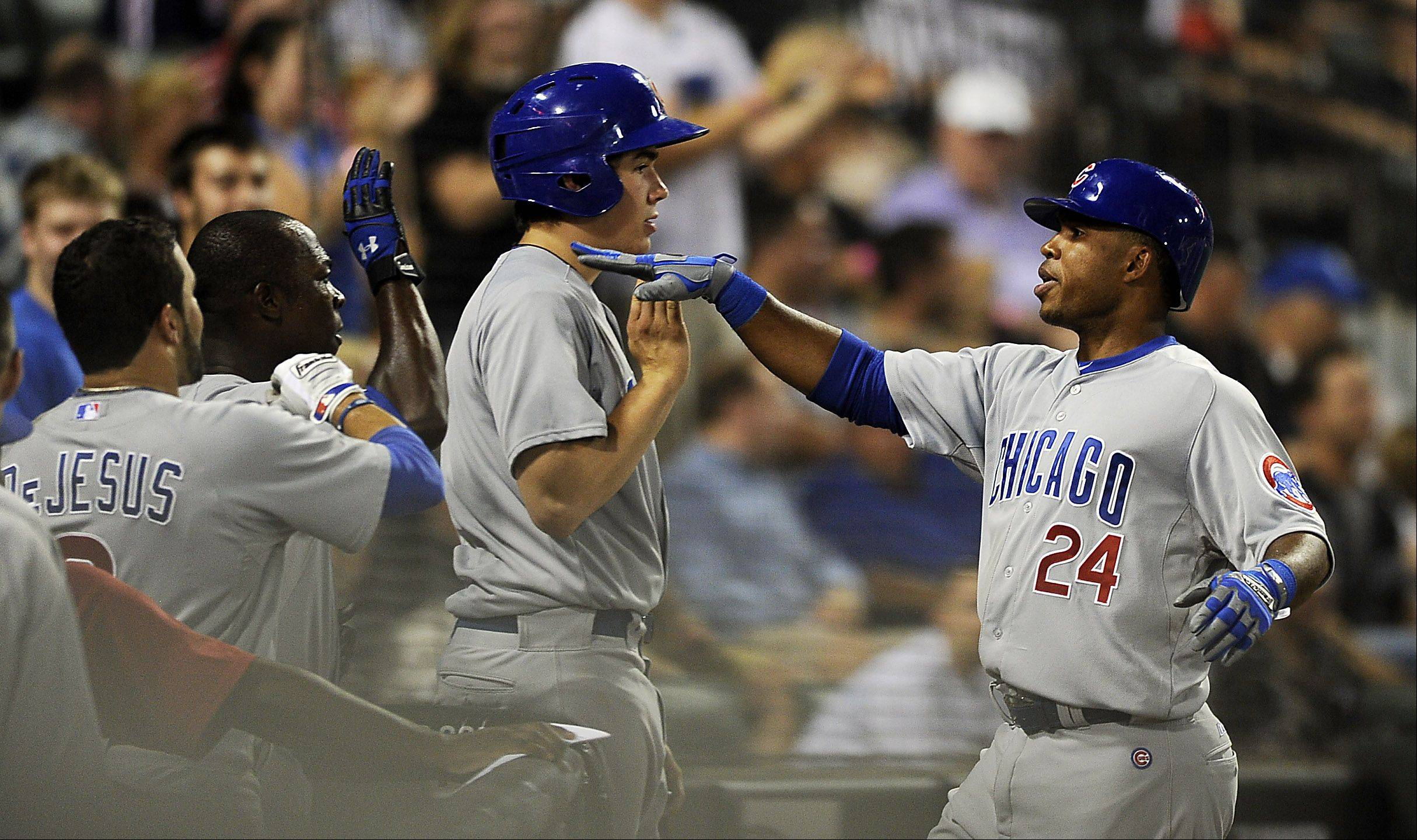 Chicago Cubs' Luis Valbuena hits a seventh inning home run.