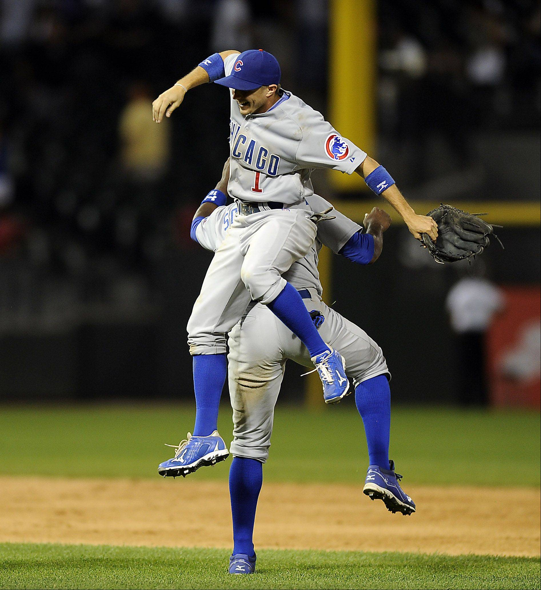 Chicago Cubs' Alfonso Soriano , back, celebrates with Tony Campana at the end of the game.