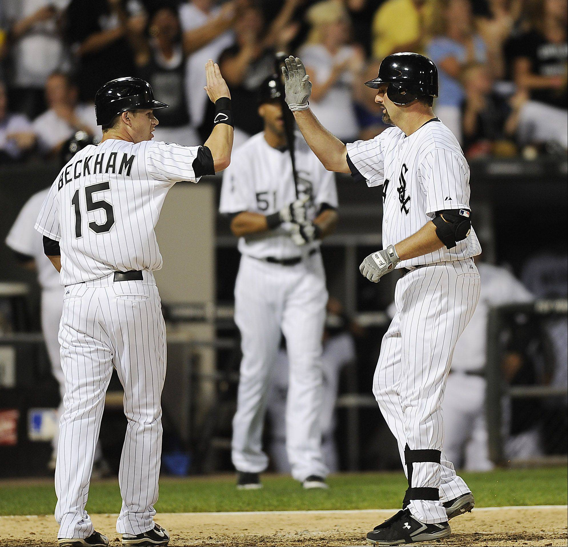 Chicago White Sox Paul Konerko celebrates a home run in the sixth inning wih teammate Gordon Beckham.