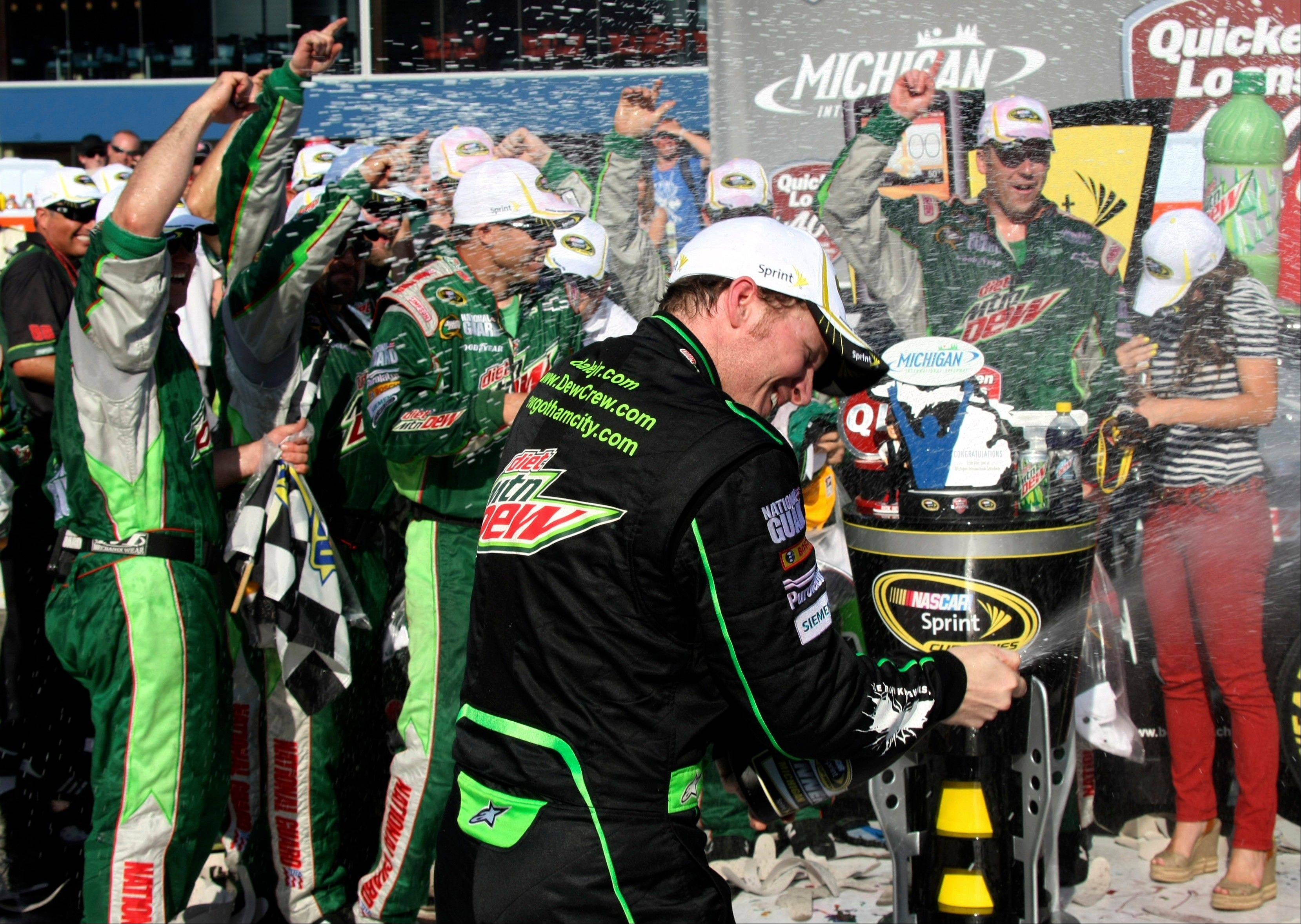 Dale Earnhardt Jr. celebrates after winning the NASCAR Sprint Cup Series Quicken Loans 400 auto race at Michigan International Speedway Sunday in Brooklyn, Mich.