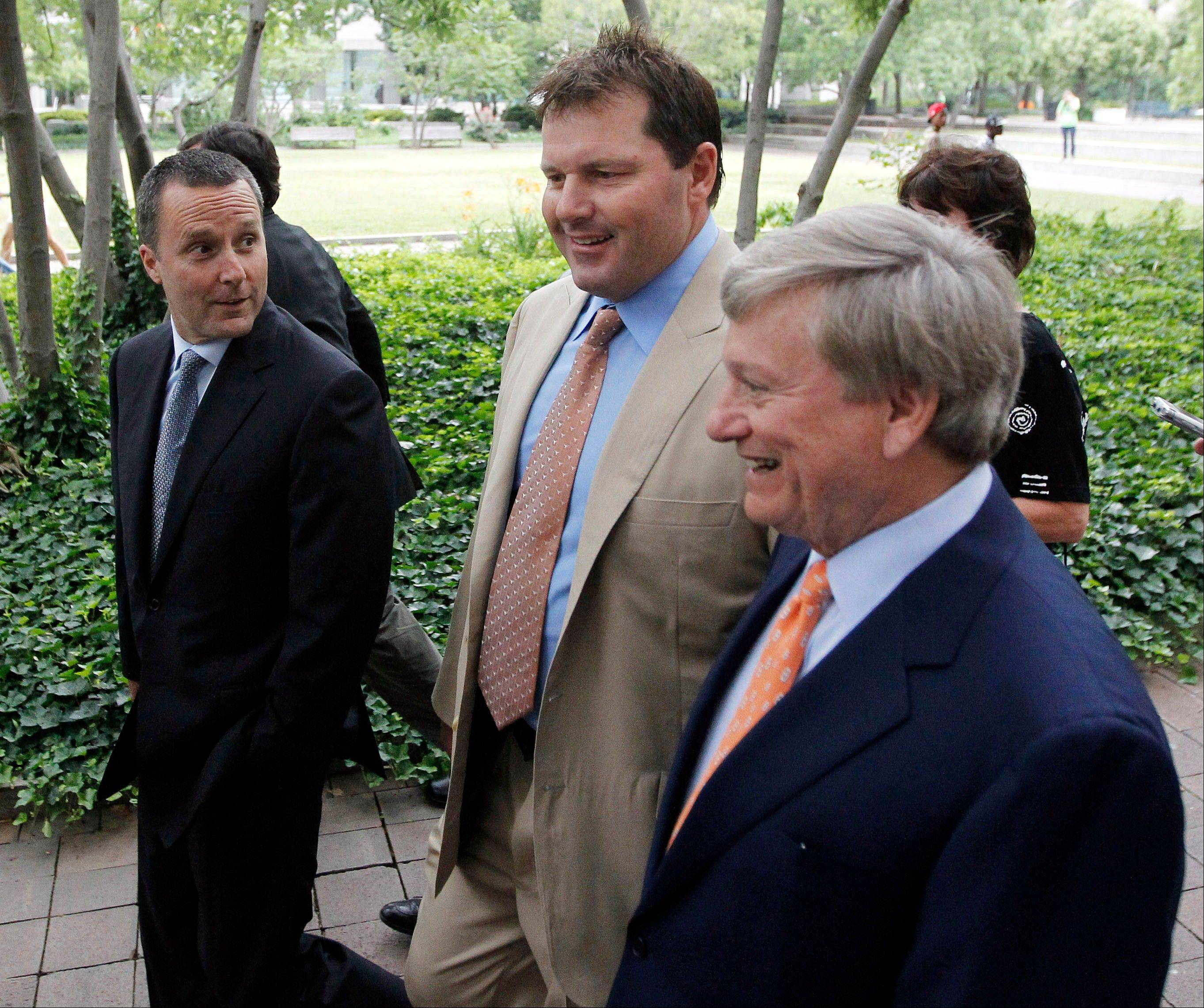 Former Major League Baseball pitcher Roger Clemens, center, and his attorney's, Rusty Hardin, right, and Michael Attanasio, left, arrive at federal court in Washington, Monday.