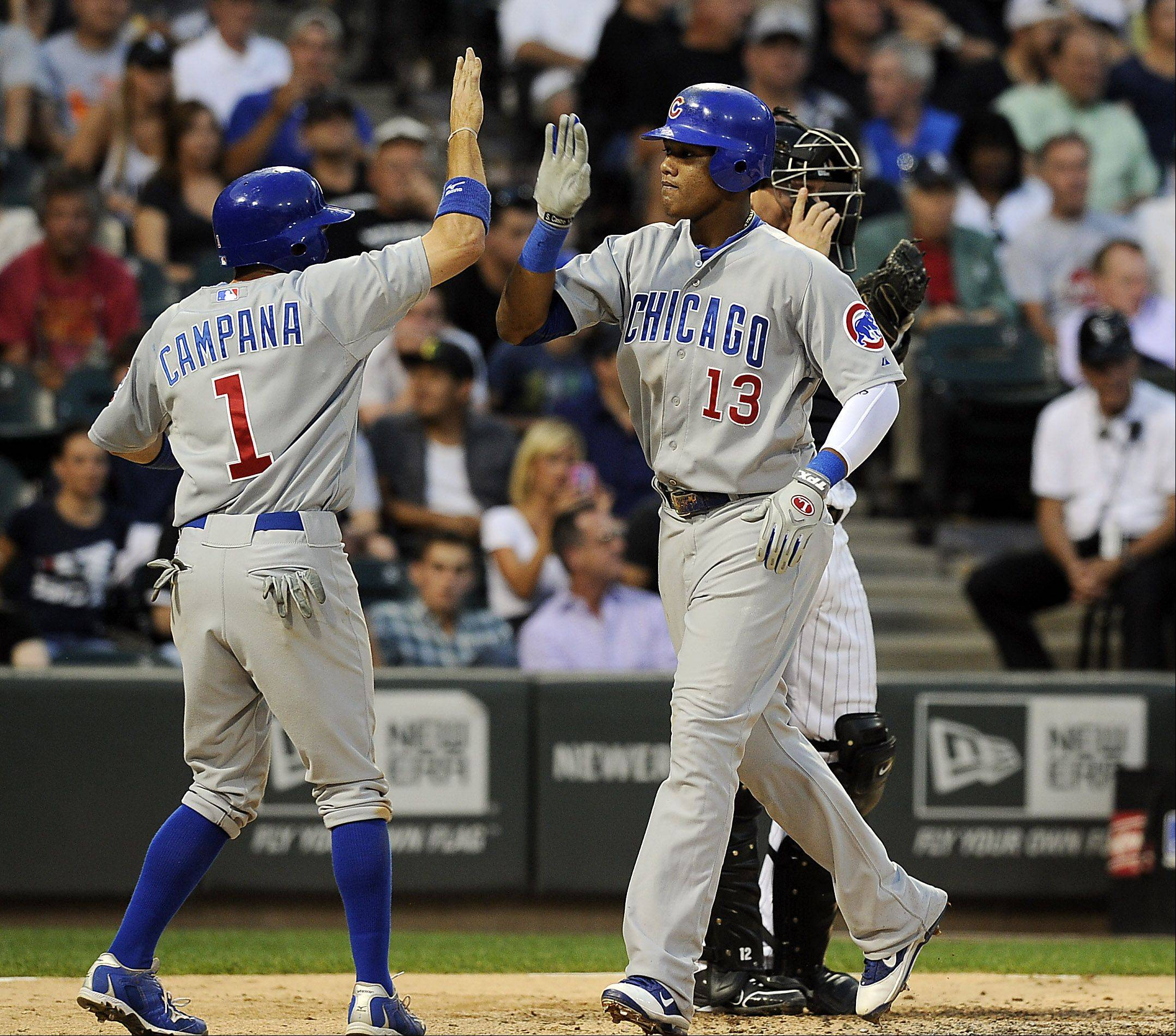 Cubs shortstop Starlin Castro celebrates after his fifth-inning homerun with teammate Tony Campana during a 12-3 victory over the White Sox on Monday at U.S. Cellular Field.