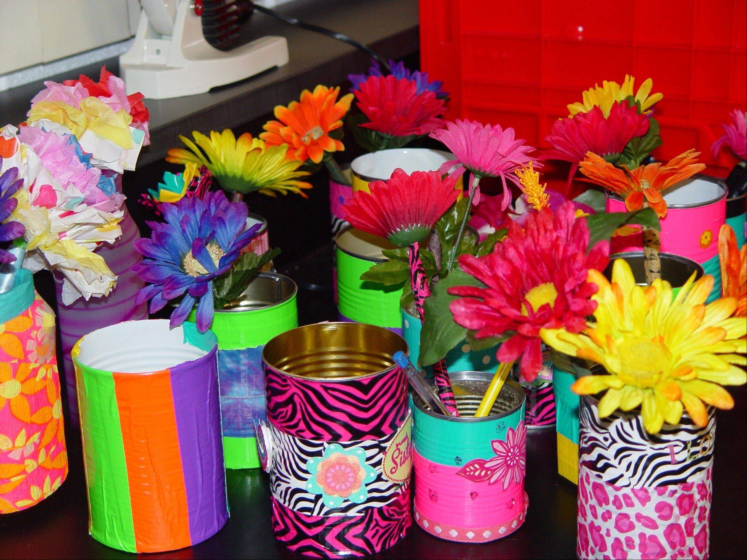 Students created colorful pencil flowers to fill homemade containers for residents at Friendship Village and PADS shelters.