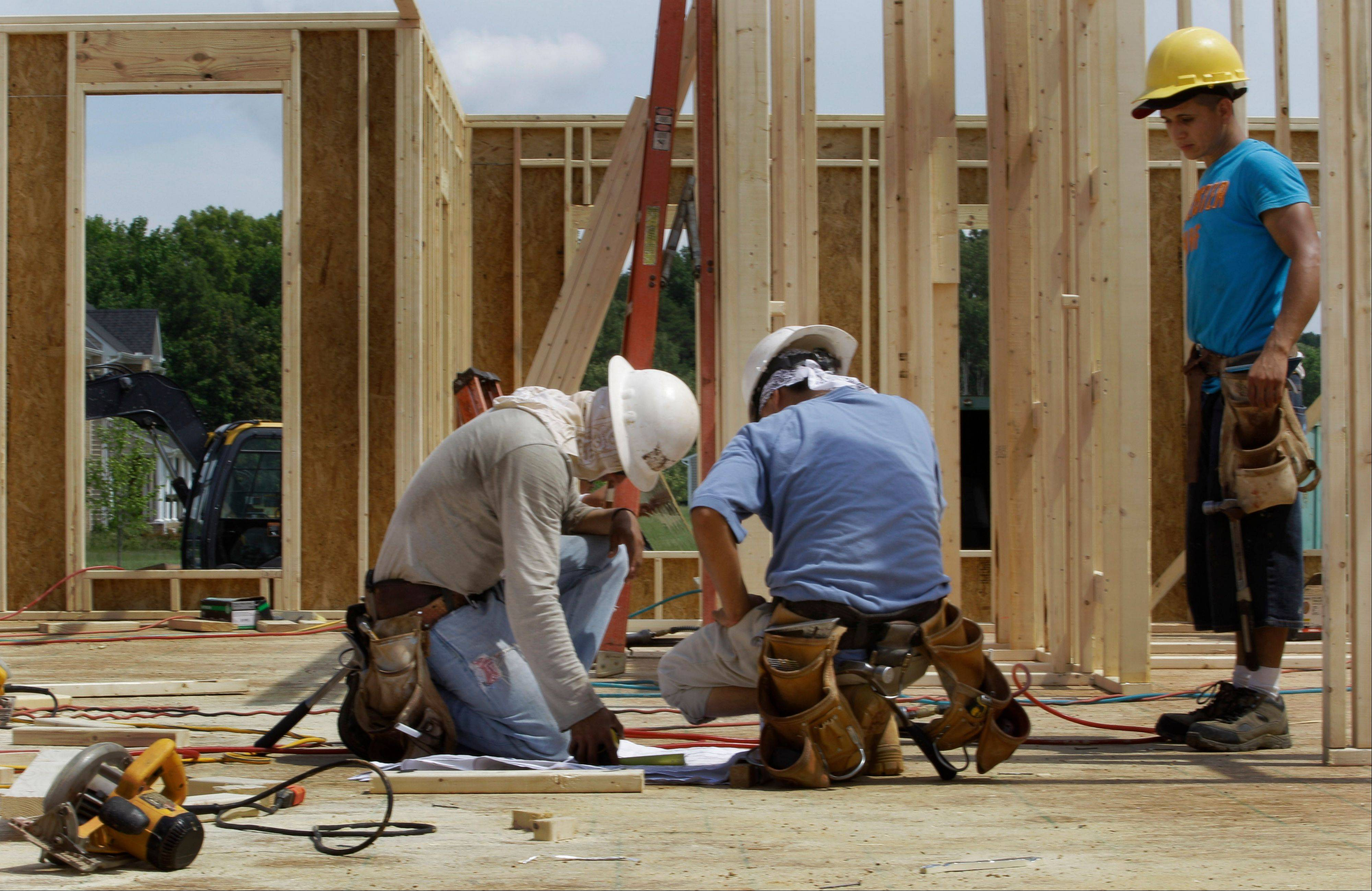 Construction workers frame a new house in Chester, Va. U.S. builders started work on more single-family homes in May and requested the most permits to build homes and apartments in three and a half years.