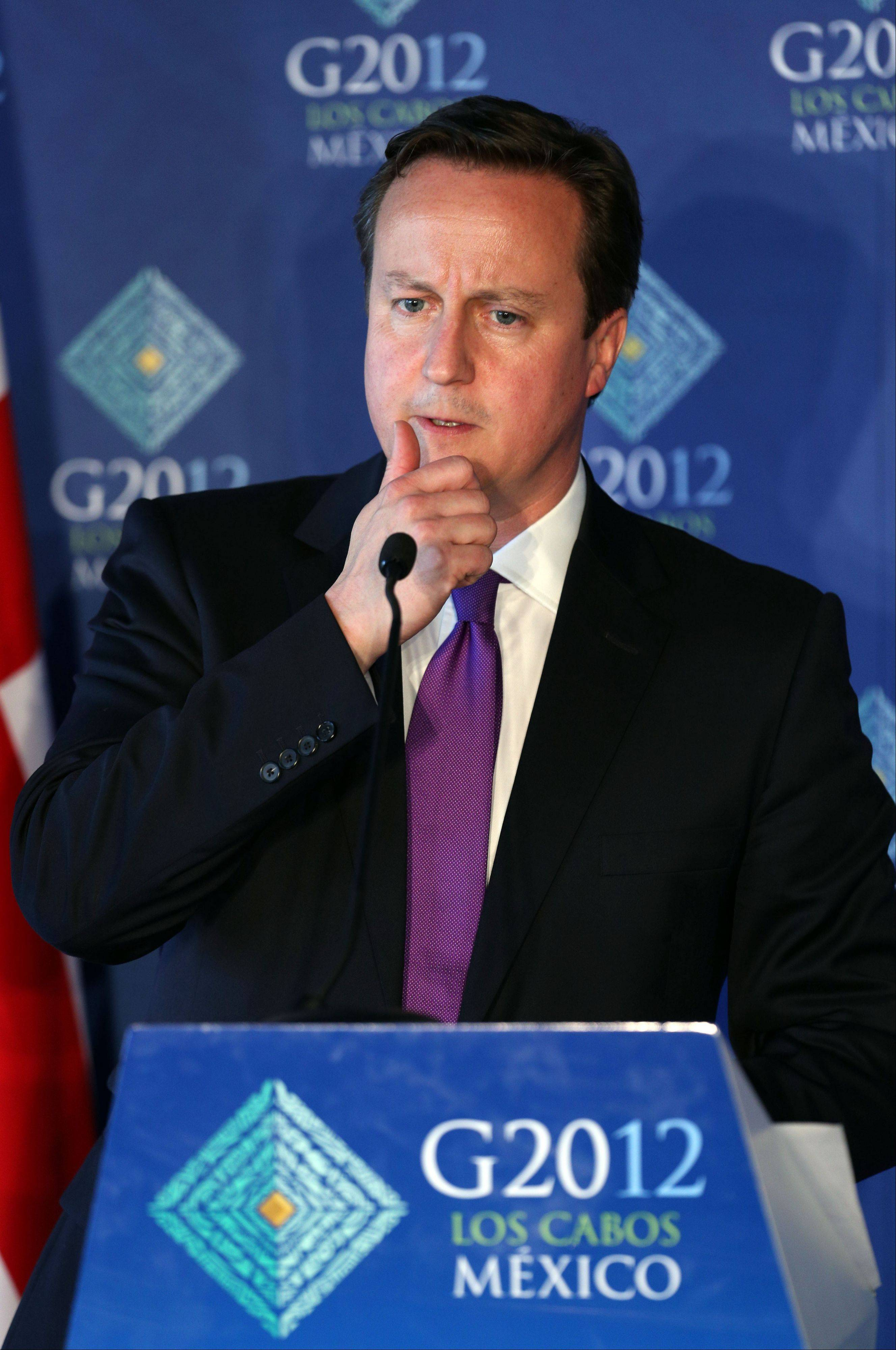 Associated PressBritish Prime Minister David Cameron ponders a question Tuesday during a news conference at the G-20 summit in Los Cabos, Mexico.
