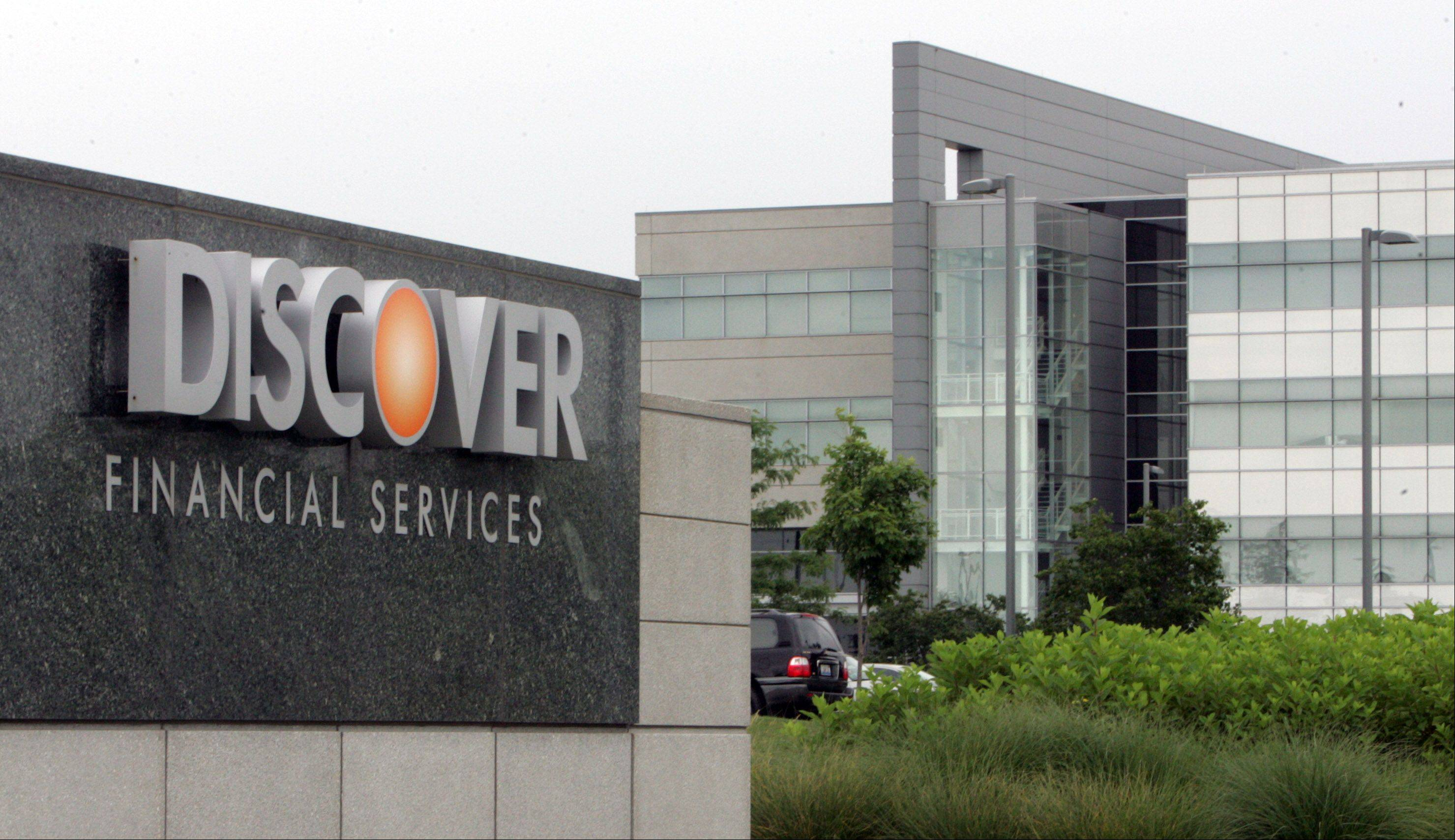 Discover Financial Services Headquarters in Riverwoods says its second-quarter net income fell 10 percent as the company freed up less money from reserves set aside to cover customers' unpaid bills.