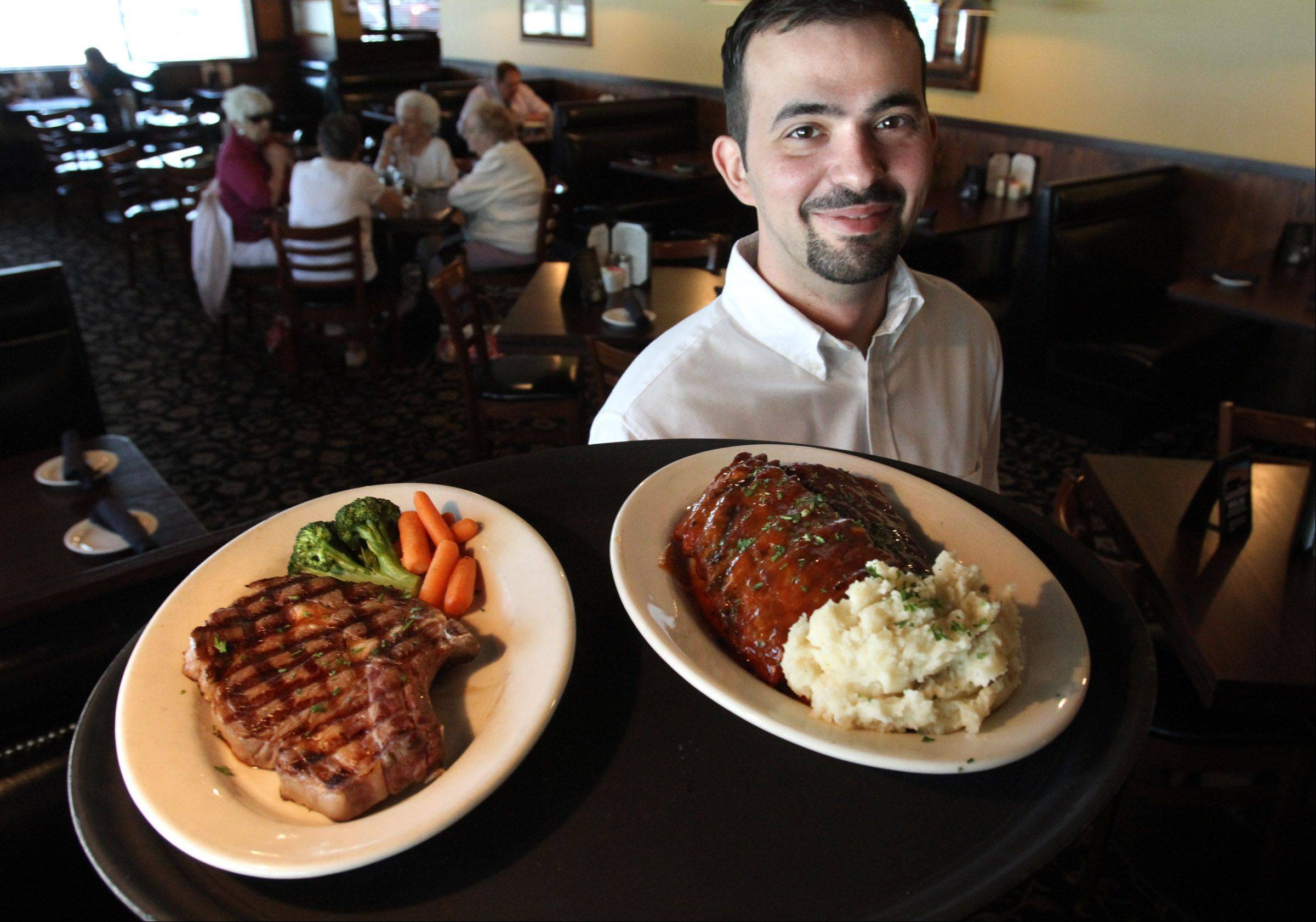Peter Kokones delivers plates of bone-in rib-eye and barbecue baby back ribs at Black Cow Kitchen & Bar in Mount Prospect.