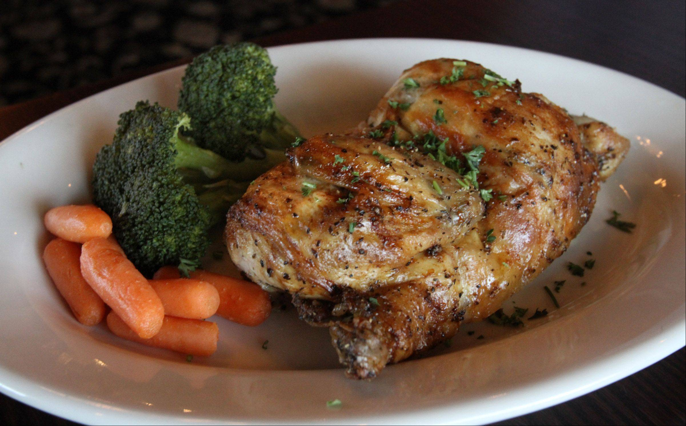 Wood-roasted chicken comes with a choice of potato or fresh vegetables at Black Cow Kitchen & Bar in Mount Prospect.