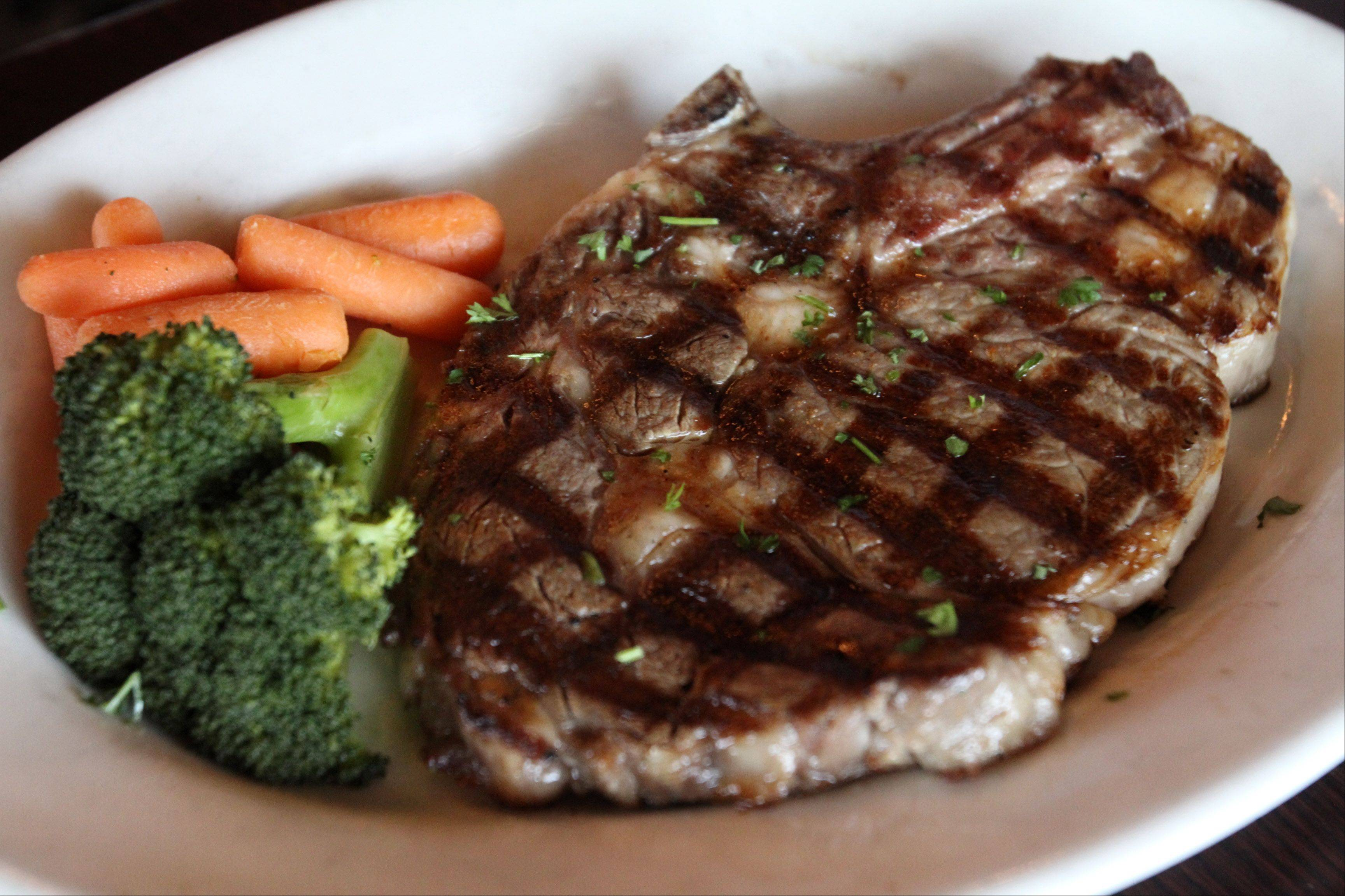 Bone-in rib-eye is one of the steak choices at Black Cow Kitchen & Bar.