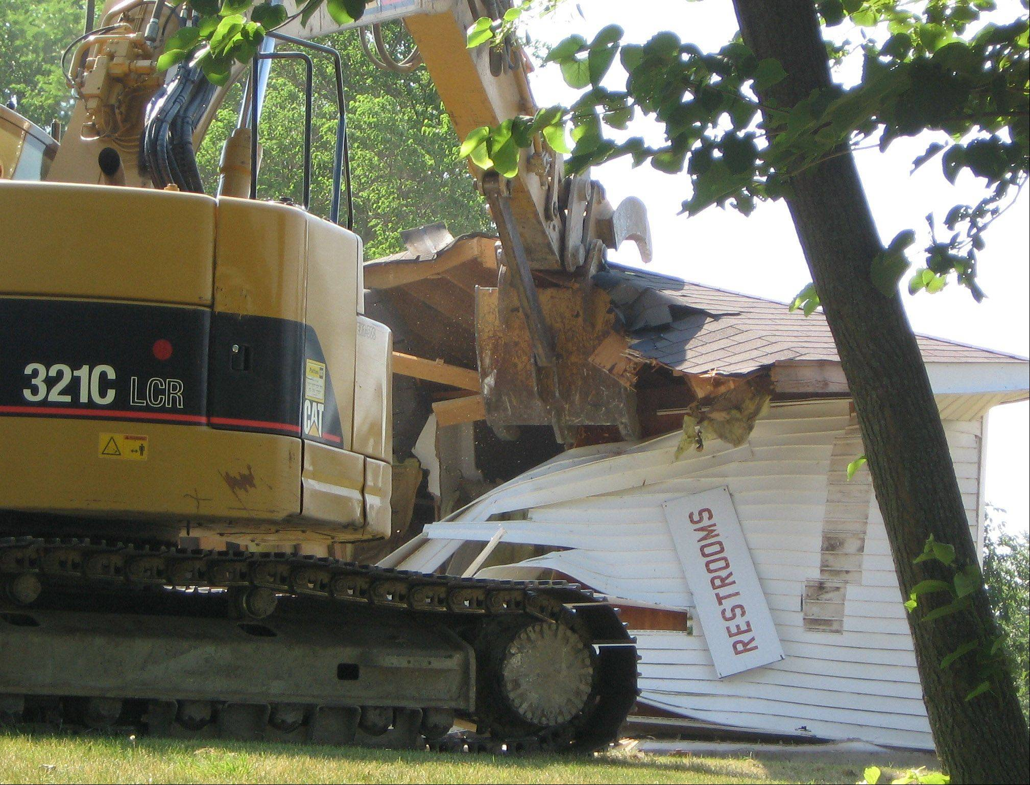 An old restroom facility in Morrison Park in Lakemoor was demolished Tuesday and will be replaced as part of an improvement plan for the lakefront park.