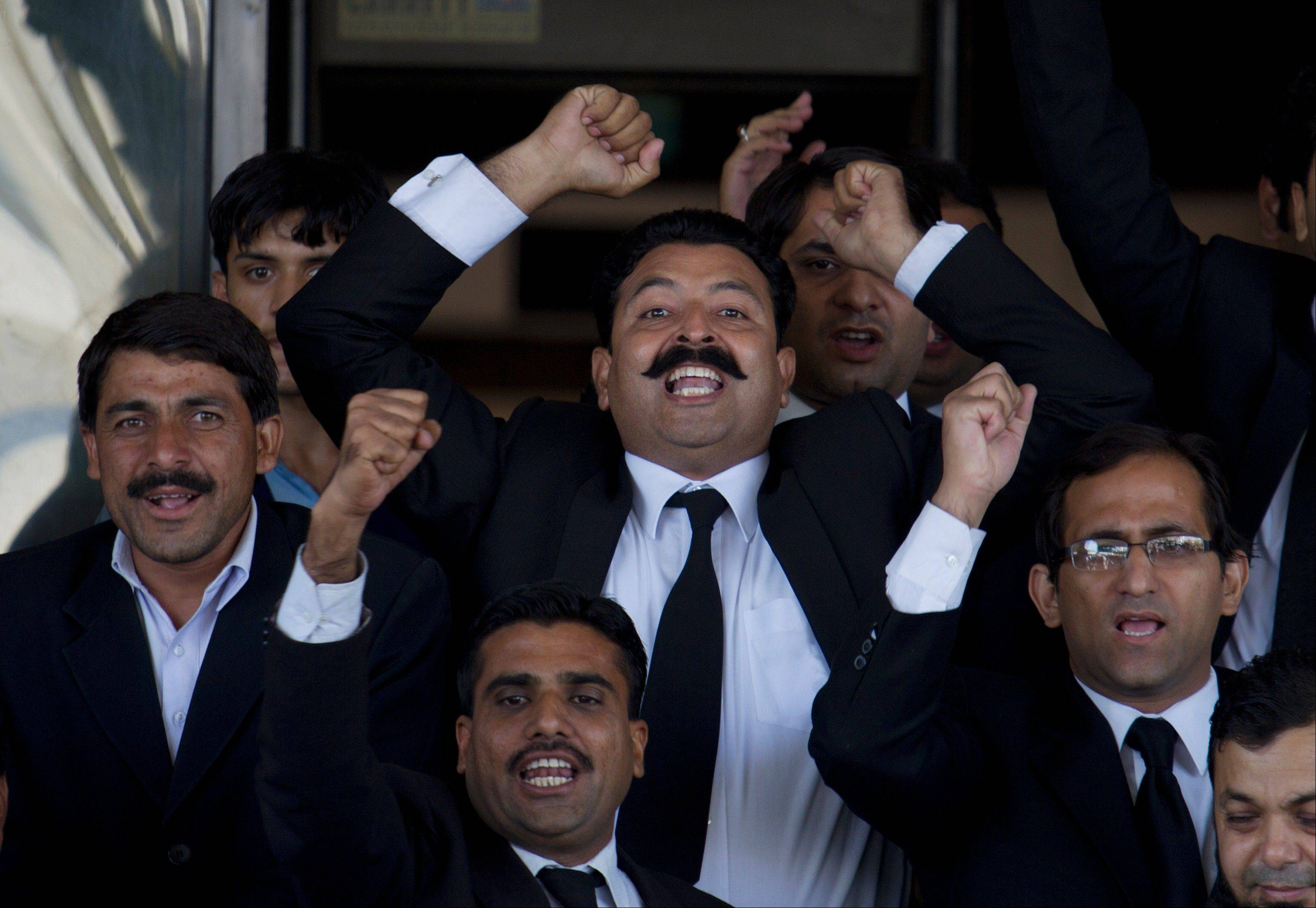 Pakistani lawyers chant slogans Tuesday in favor of the Supreme Court's decision against Pakistan's Prime Minister, Yousuf Reza Gilani, outside the court in Islamabad, Pakistan.
