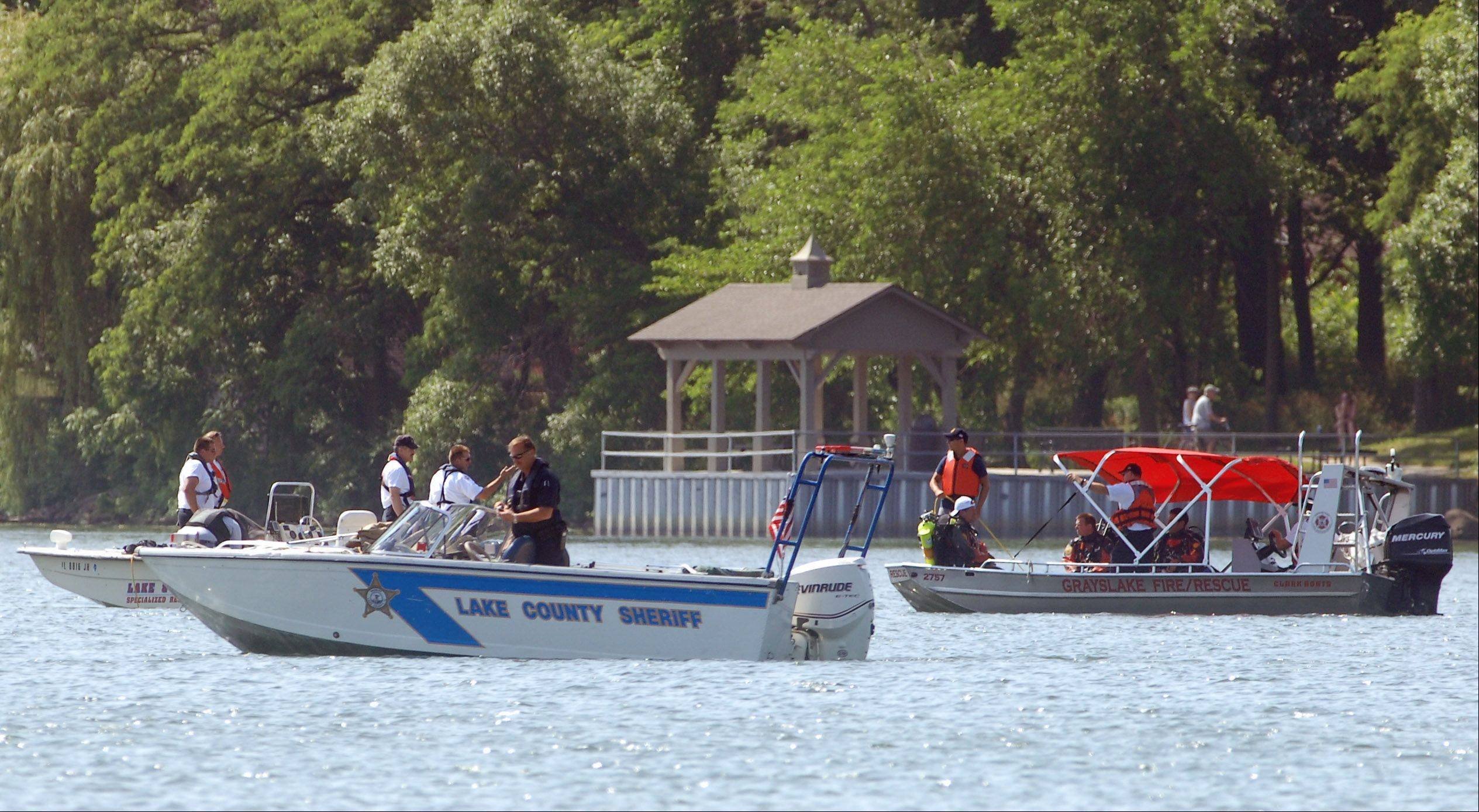 Divers search for a missing swimmer on Gages Lake Tuesday morning near Grayslake.