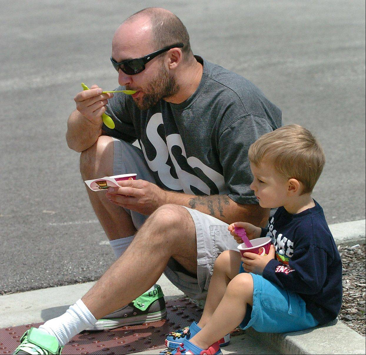 Bart Smagacz and his son, Niko, enjoy some frozen yogurt outside the new Menchie's frozen yogurt in Mount Prospect.