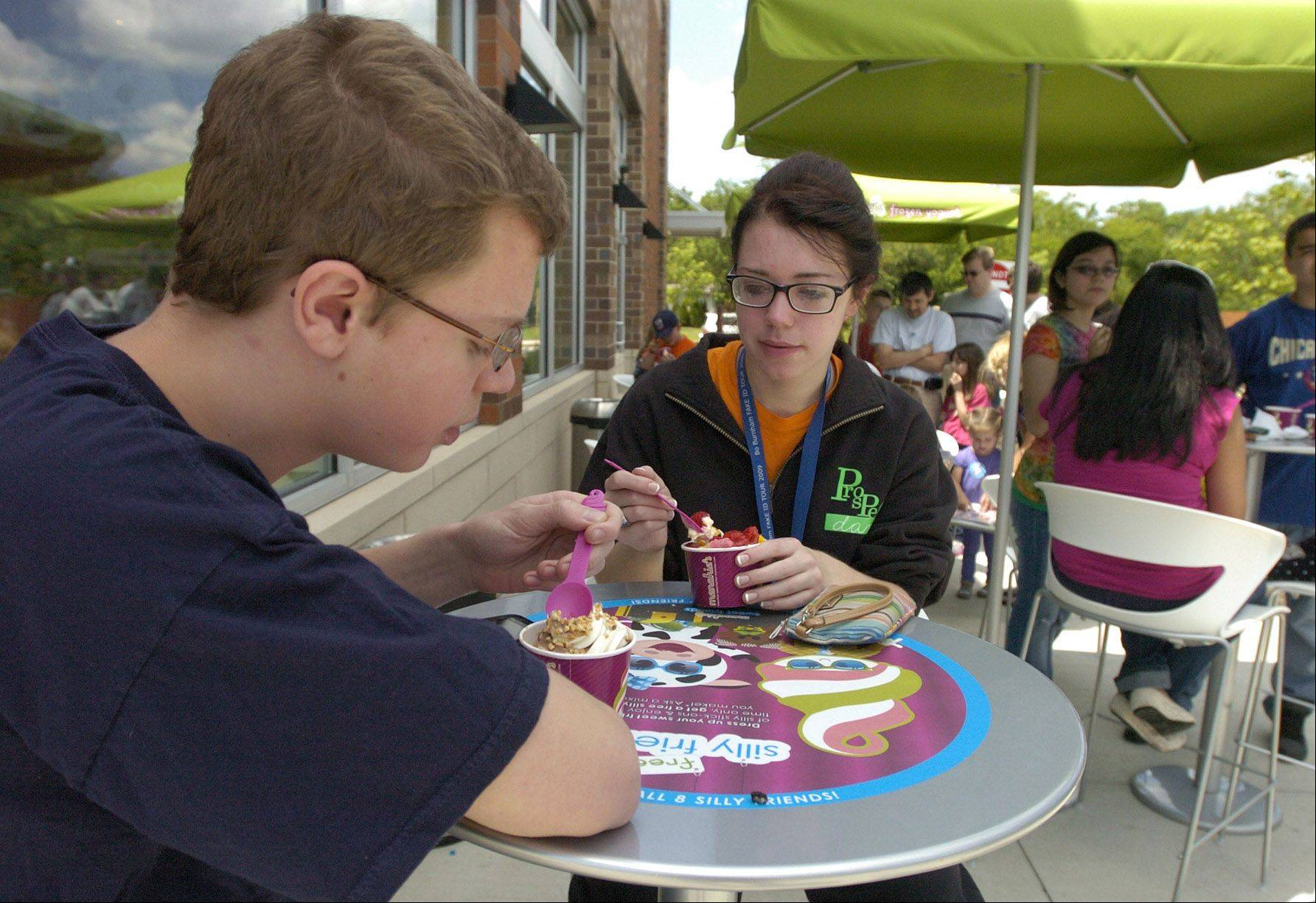Tom and Julie Winter of Arlington Heights try a free sample at the new Menchie's frozen yogurt in Mount Prospect.