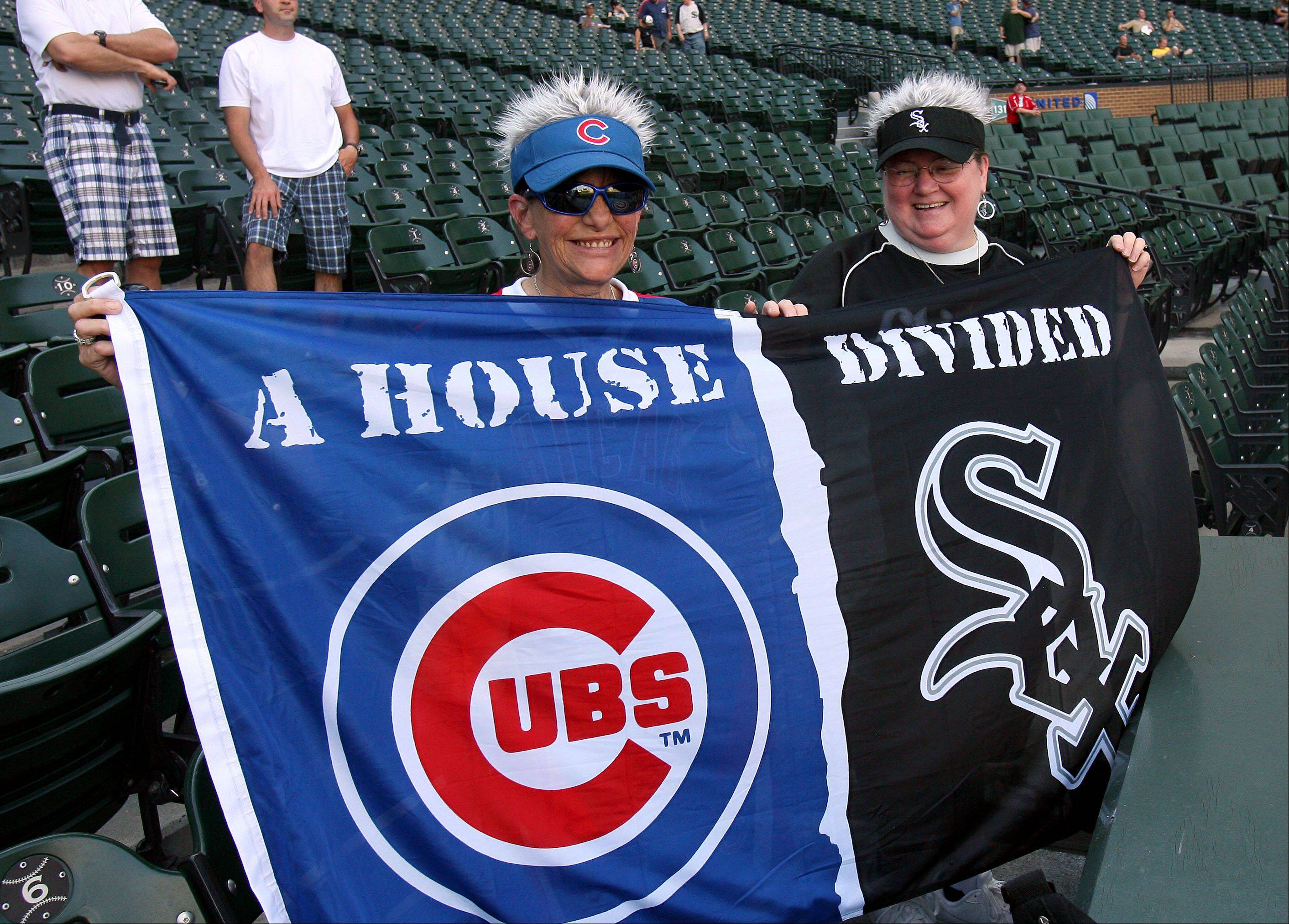 Peggy Sotlin, left, of Landcaster, California and her friend Marie Fobes of Chicago display their allegiances before the game.