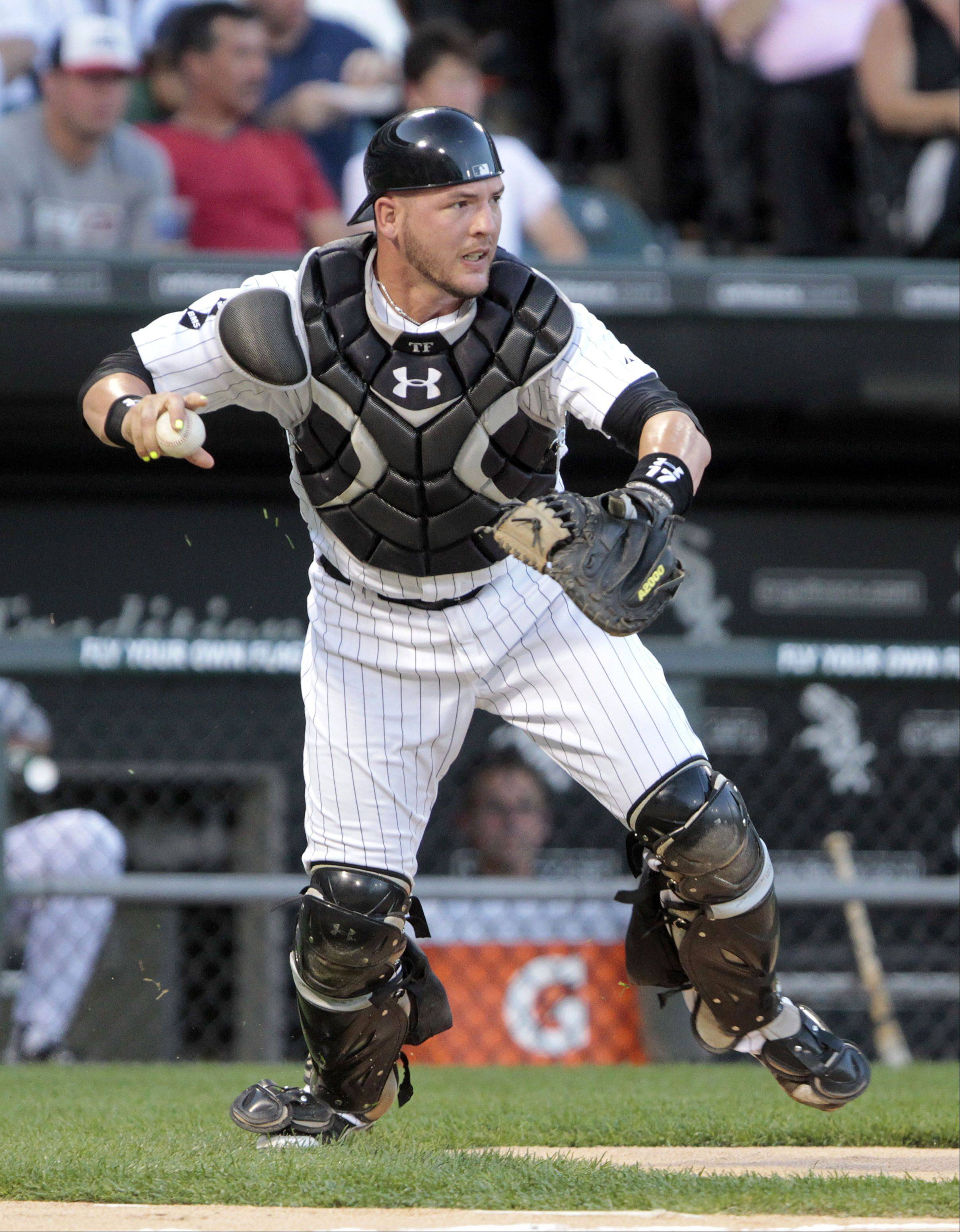 Chicago White Sox's Tyler Flowers looks for action.
