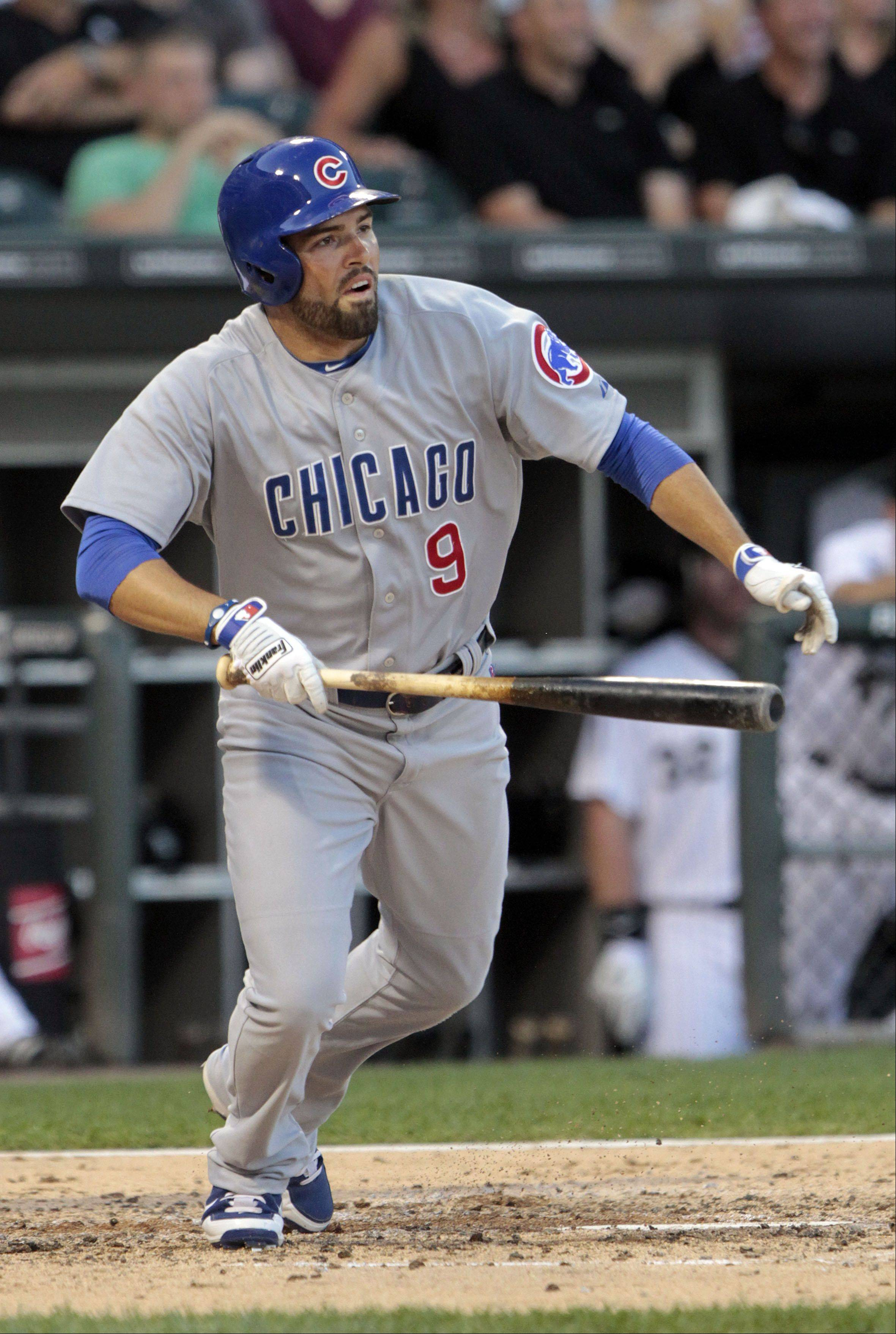 Chicago Cubs' David DeJesus watches his single in the third inning.